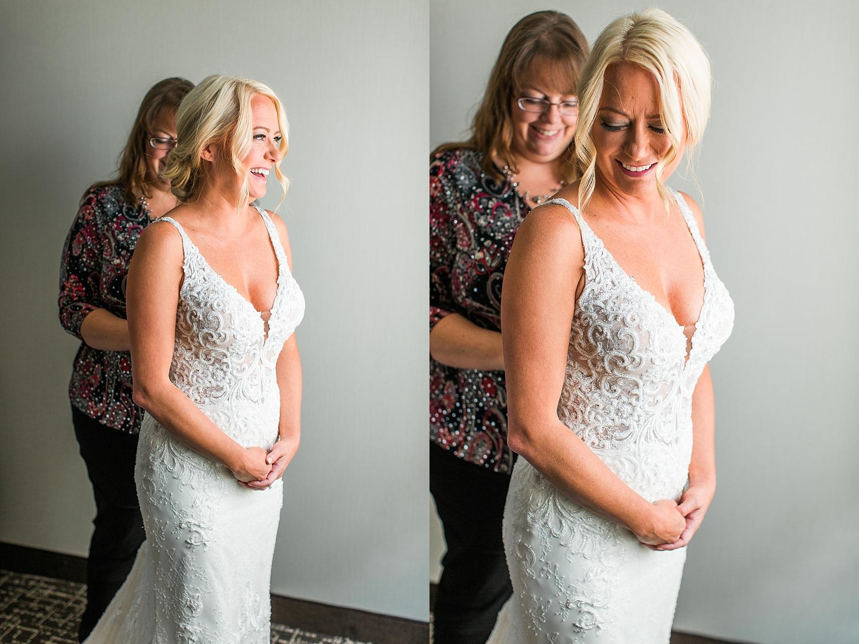 Bride getting wedding dress buttoned for wedding at the Chart House Summer Wedding Lakeville Minnesota Minneapolis Wedding Photographer Mallory Kiesow