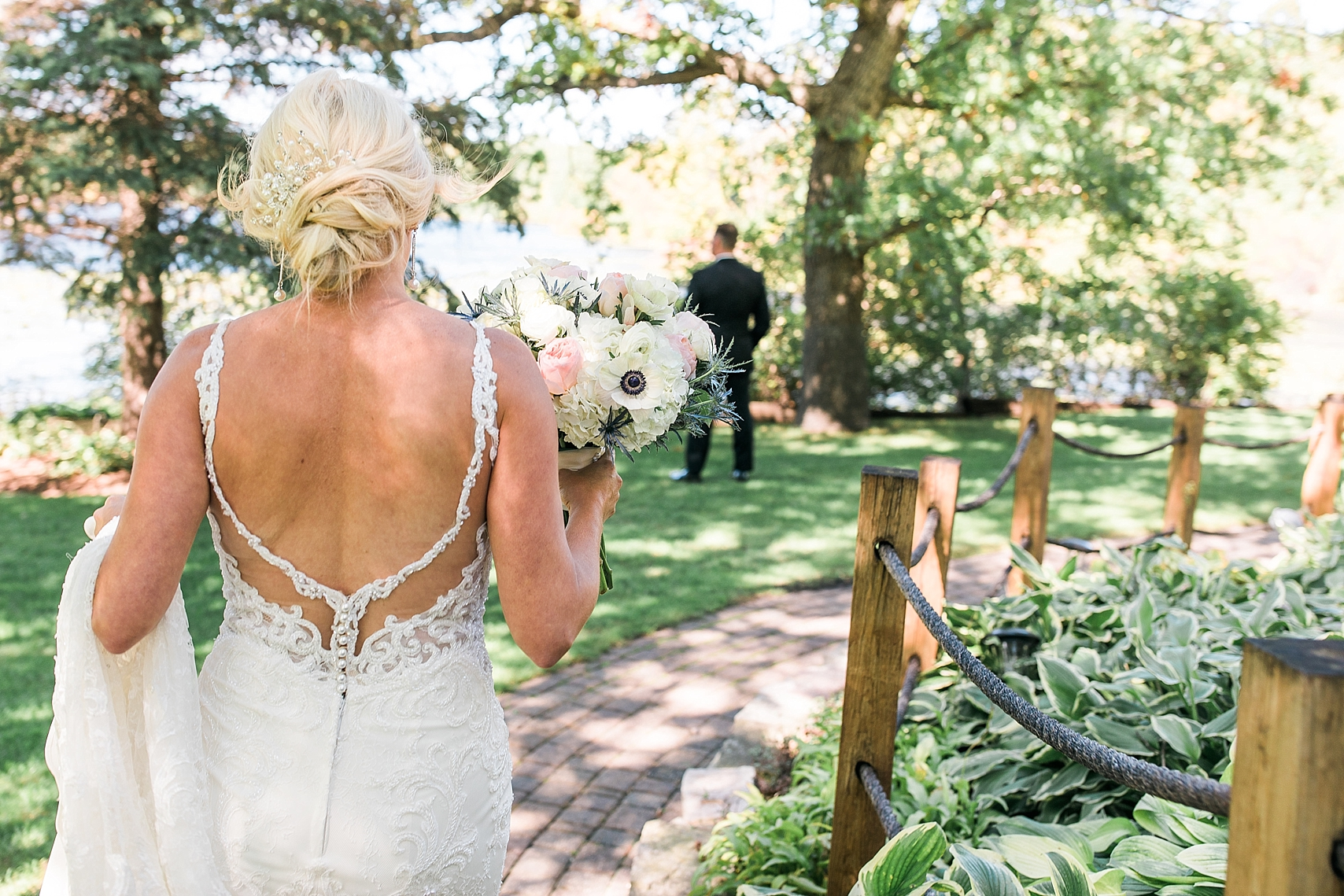 Bride first look with groom for wedding at the Chart House Summer Wedding Lakeville Minnesota Minneapolis Wedding Photographer Mallory Kiesow