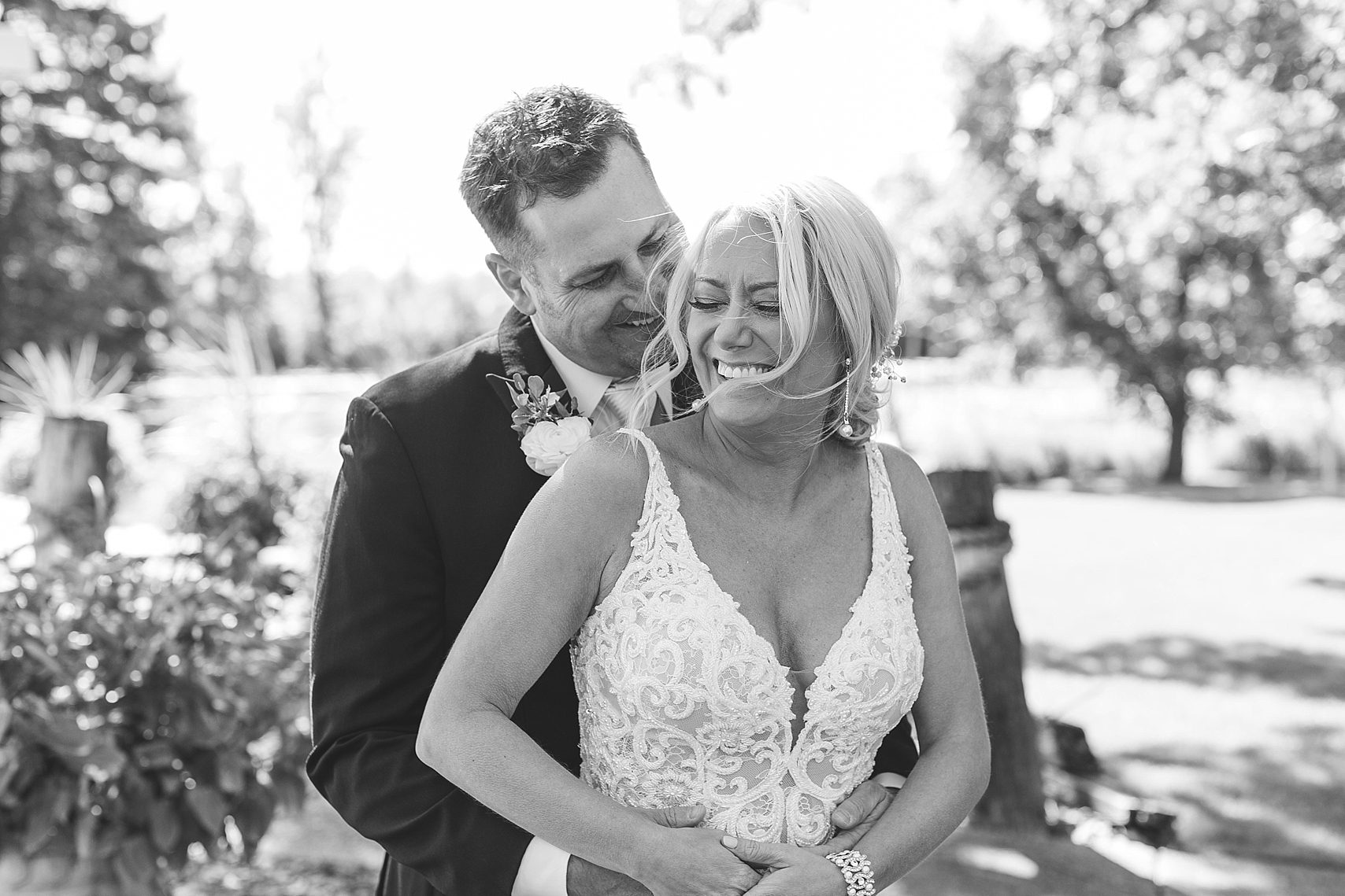 Bride and groom laughing black and white on wedding day at the Chart House Summer Wedding Lakeville Minnesota Minneapolis Wedding Photographer Mallory Kiesow