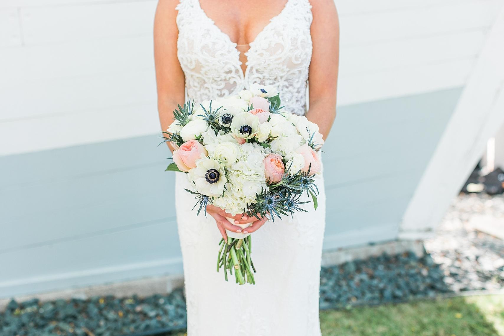 Bridal portrait holding bouquet on wedding day at the Chart House Summer Wedding Lakeville Minnesota Minneapolis Wedding Photographer Mallory Kiesow
