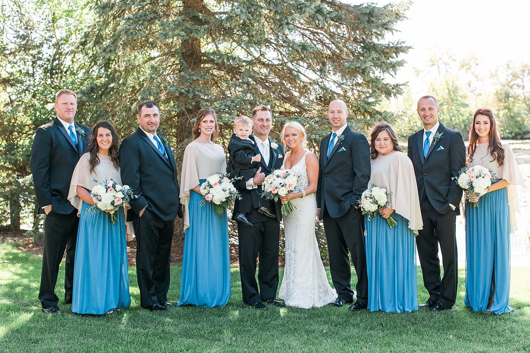 Wedding party black suits blue dresses on wedding day at the Chart House Summer Wedding Lakeville Minnesota Minneapolis Wedding Photographer Mallory Kiesow