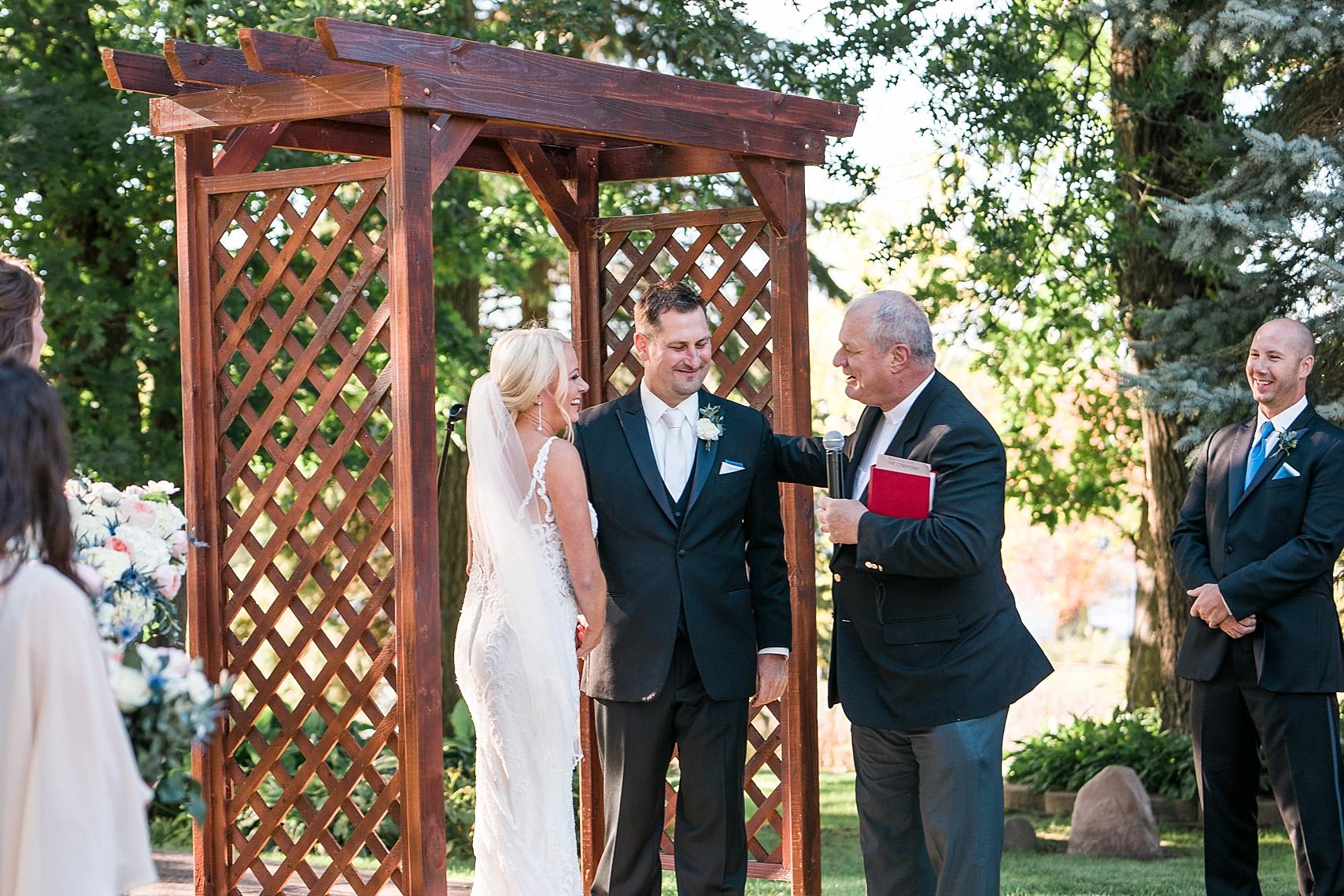 Outdoor wedding ceremony at the Chart House Summer Wedding Lakeville Minnesota Minneapolis Wedding Photographer Mallory Kiesow