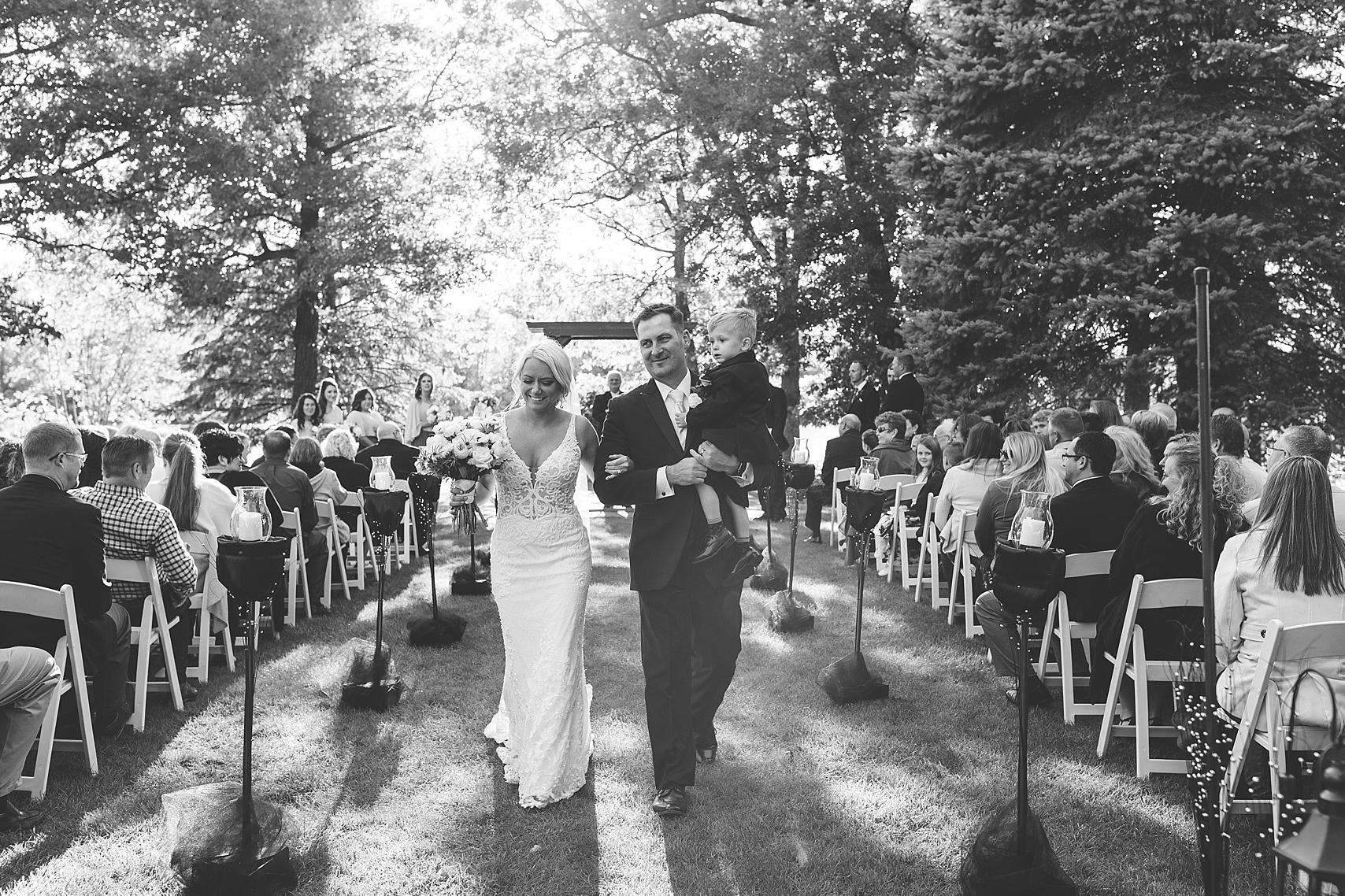 Outdoor wedding ceremony celebratory exit at the Chart House Summer Wedding Lakeville Minnesota Minneapolis Wedding Photographer Mallory Kiesow