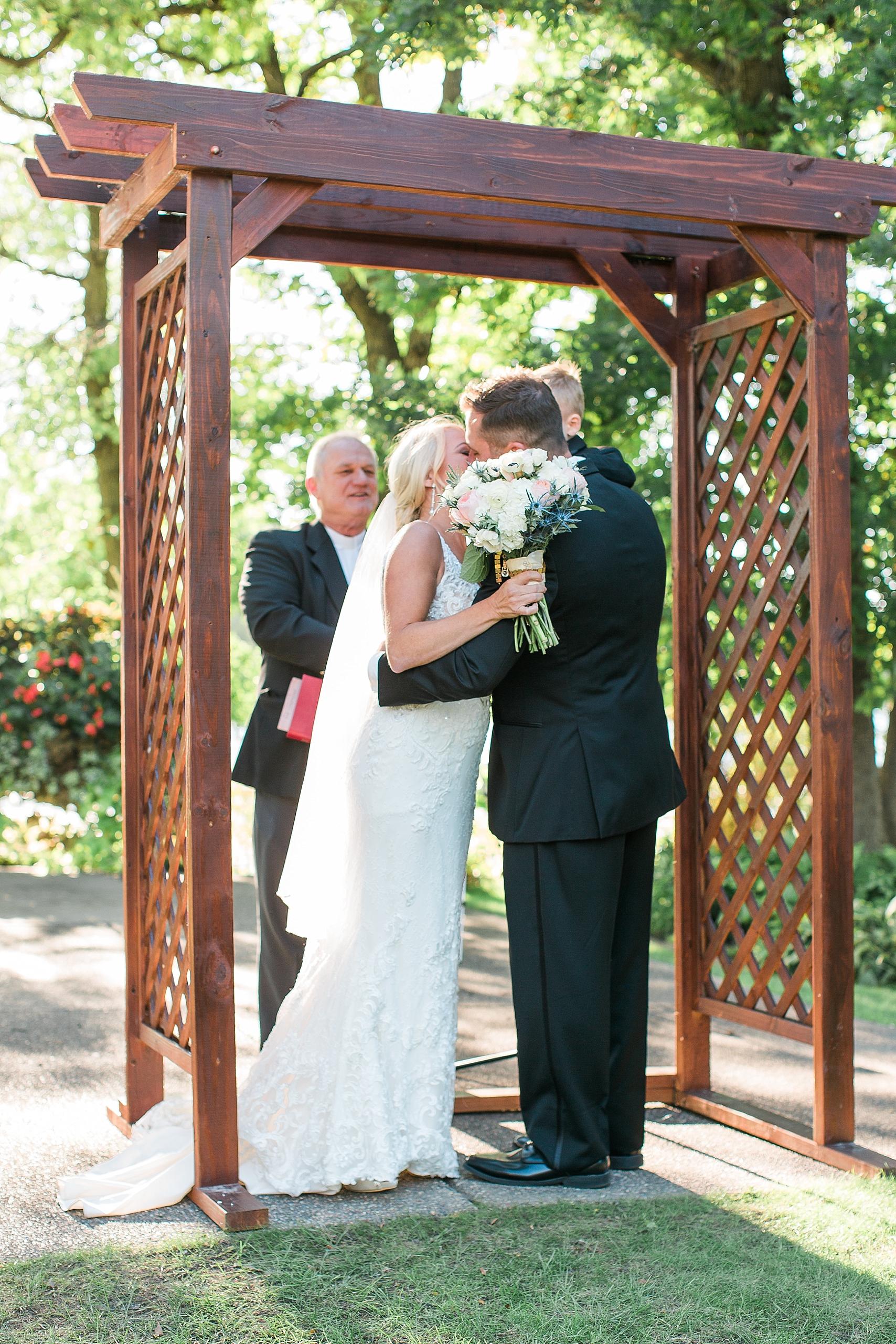 Outdoor wedding ceremony kiss at the Chart House Summer Wedding Lakeville Minnesota Minneapolis Wedding Photographer Mallory Kiesow