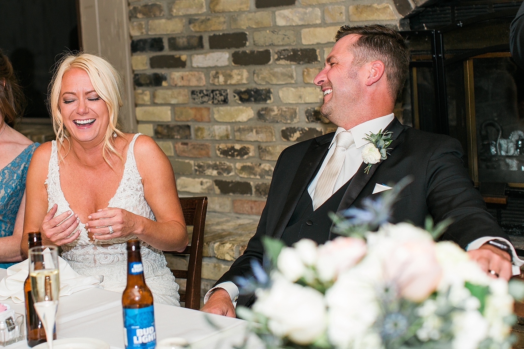 Bride and groom laughing at speech at the Chart House Summer Wedding Lakeville Minnesota Minneapolis Wedding Photographer Mallory Kiesow