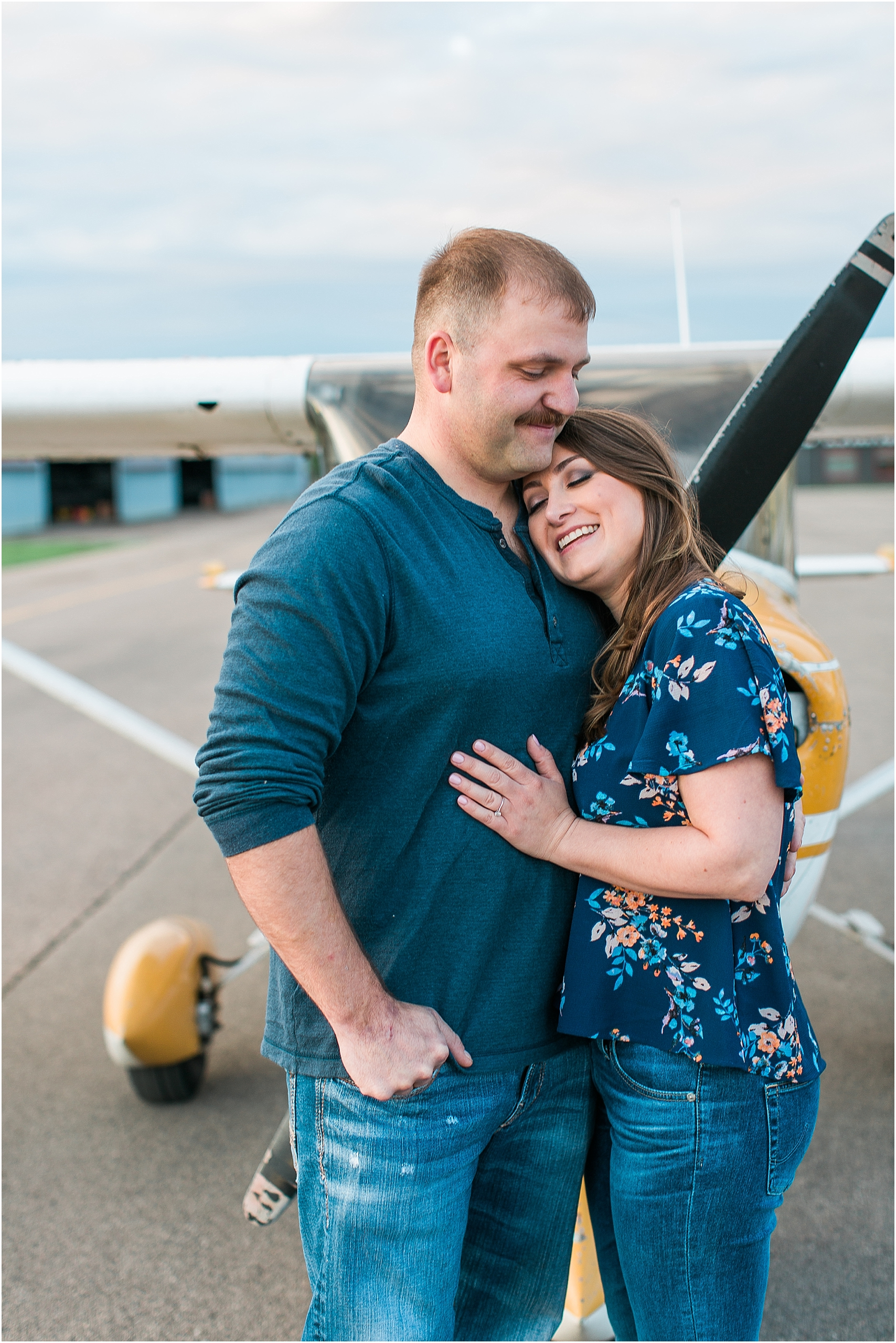 Minneapolis airplane engagement photography session at flying cloud airport in Eden Prairie photographed by Mallory Kiesow Minneapolis engagement and wedding photographer_10.jpg