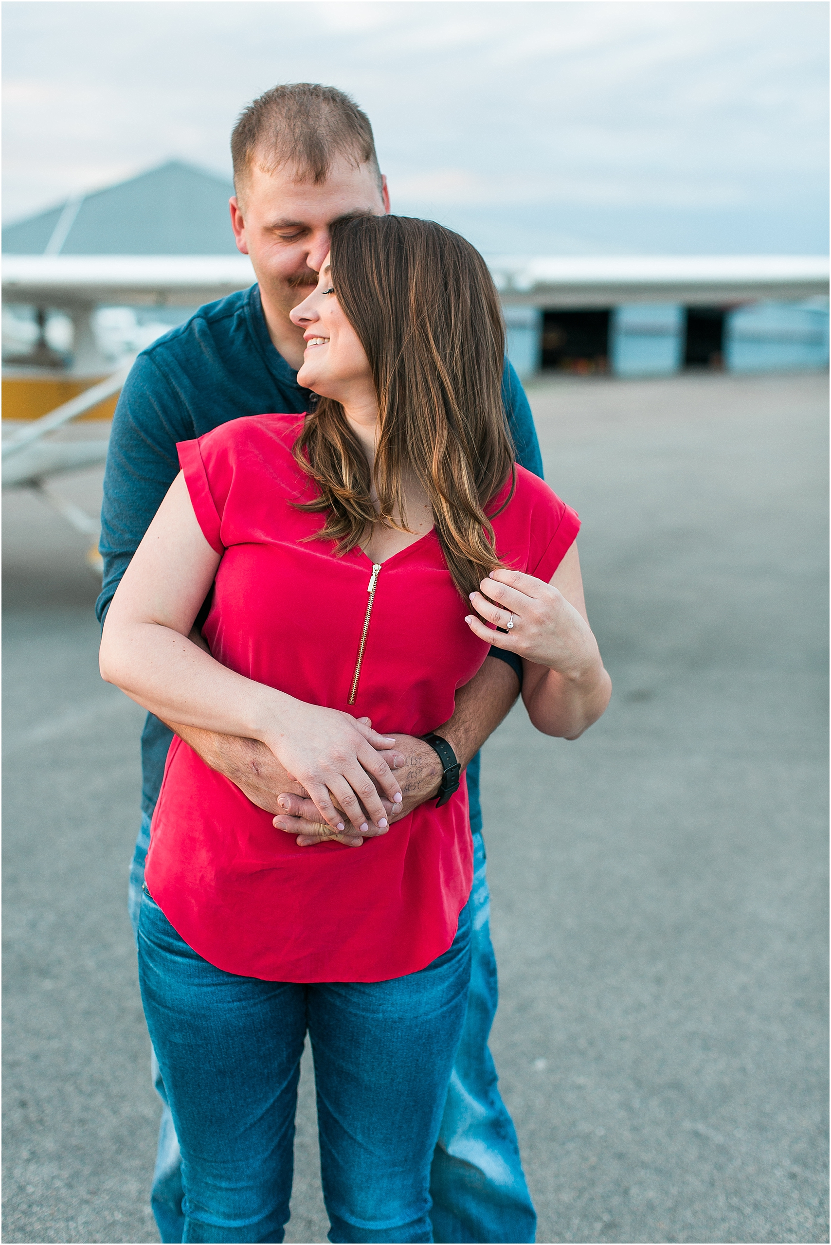 Minneapolis airplane engagement photography session at flying cloud airport in Eden Prairie photographed by Mallory Kiesow Minneapolis engagement and wedding photographer_14.jpg