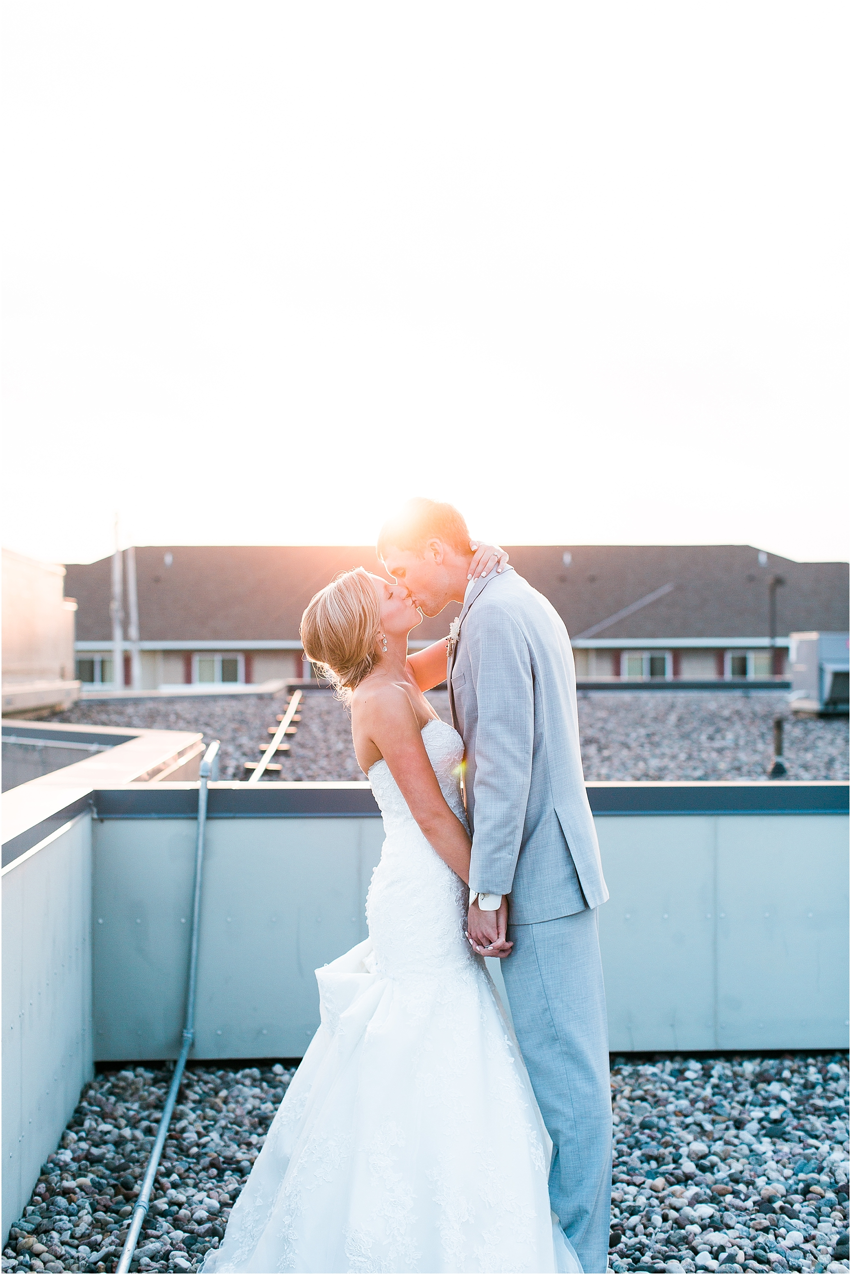 Bride and groom sunset rooftop portrait outside at Minnesota summer wedding in Buffalo MN photographed by Mallory Kiesow, Minnesota wedding photographer