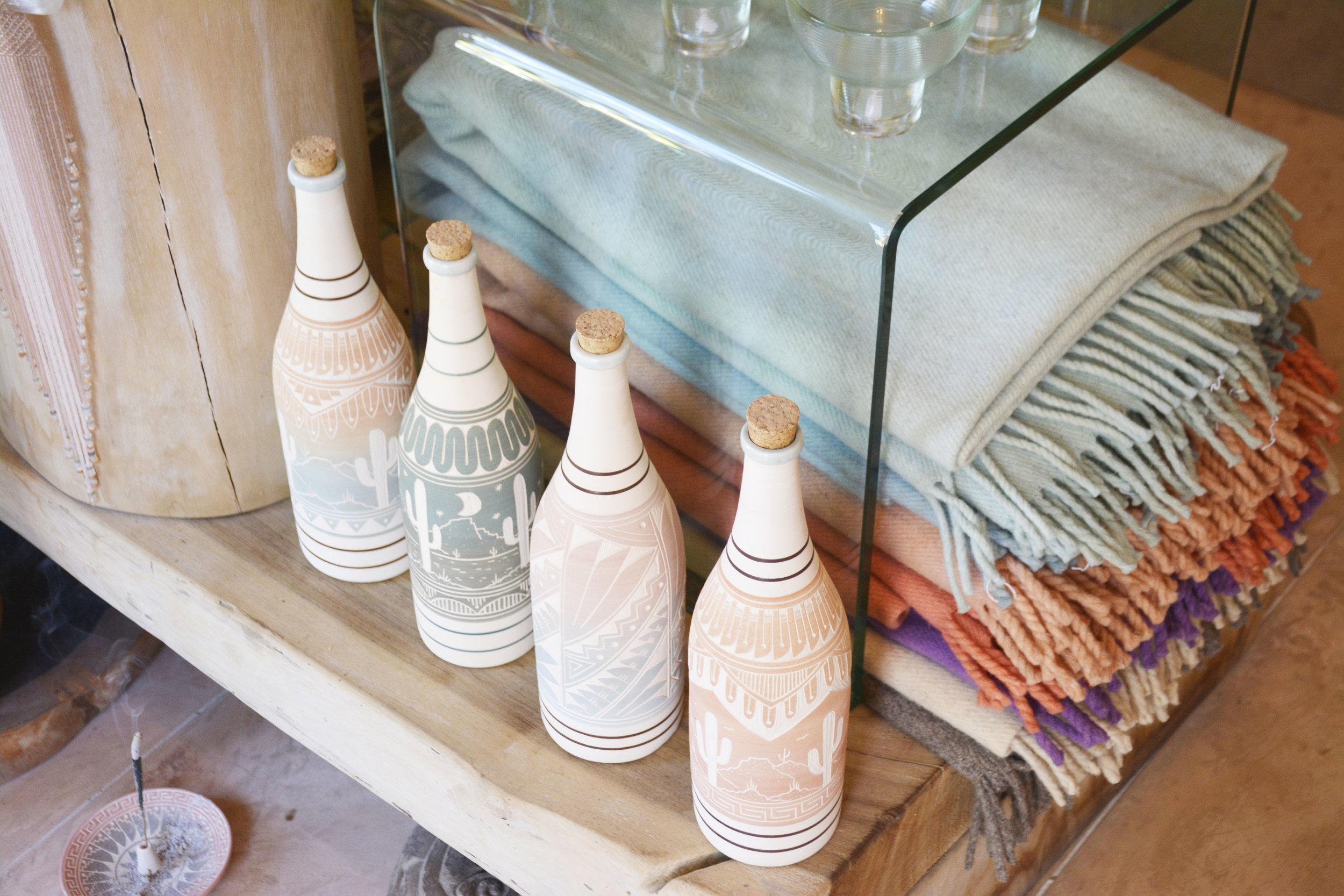 Hand carved and painted water bottles at  Evoke