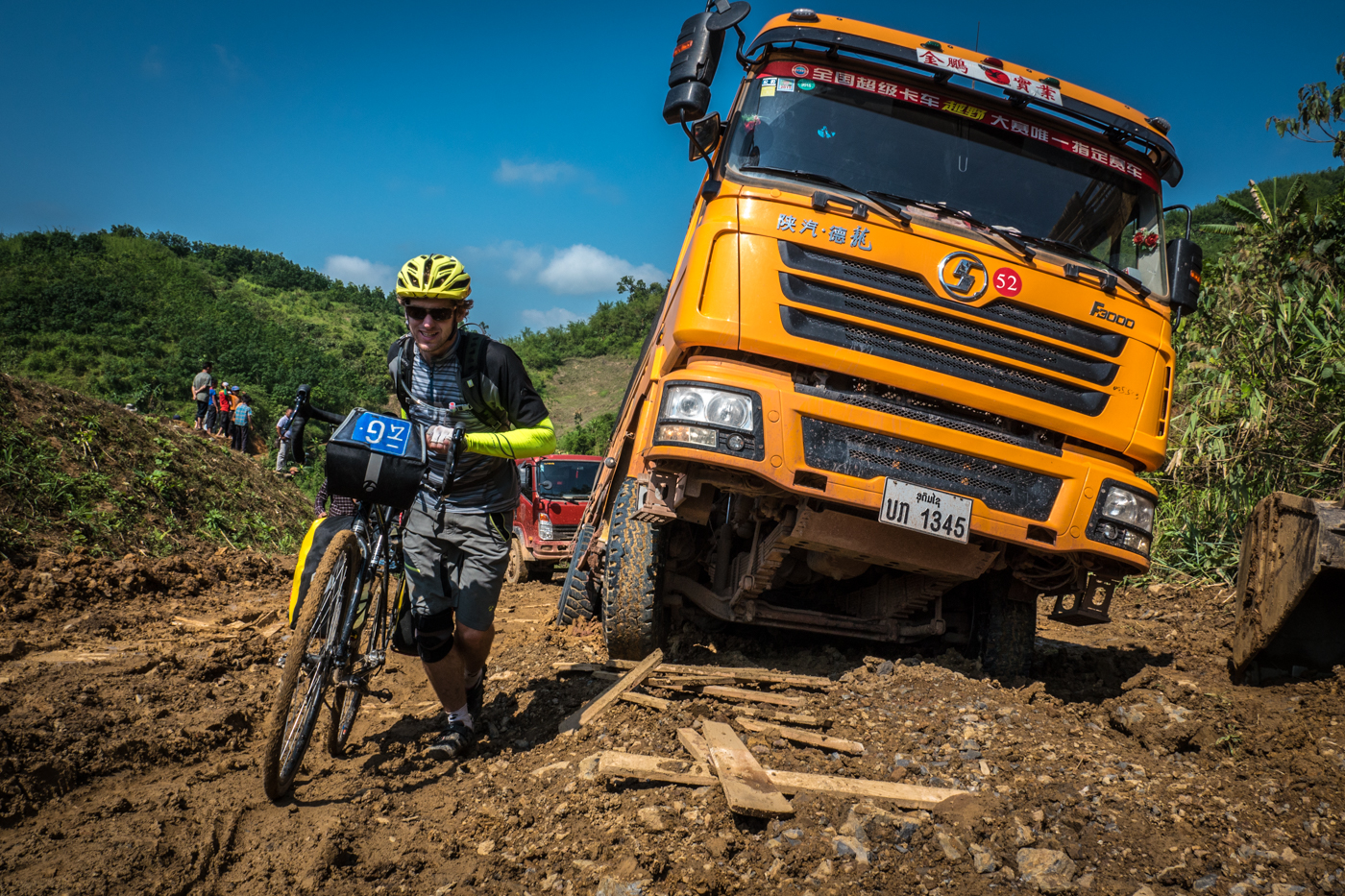 Kyle pushes through the muck alongside Chinese trucks. Photo: Will Stauffer Norris