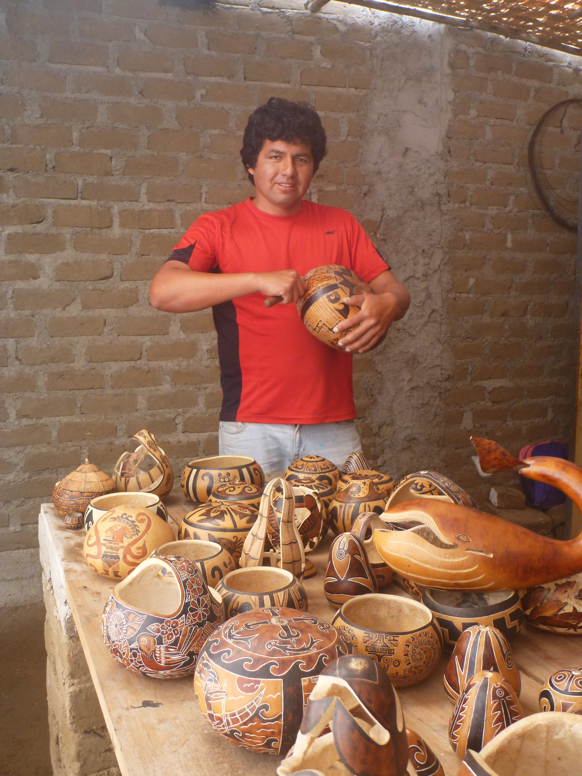 The Project   In 2012, SPI provided a grant to Pampas Gramalote for artisanal and touristic development around the site and in the local community. The project invested in local resident and master-craftsman Ivan Cruz, to expand his gourd carving business and spread his experience with new artisans in the community. Alongside this, SPI provided infrastructure for an artisan training center, and new space for retail and exhibitions about the site for locals and tourists.