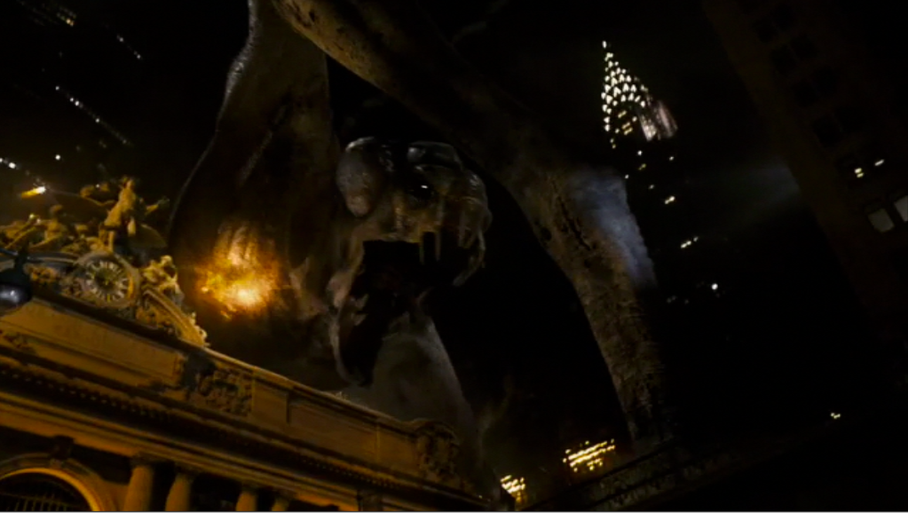 Still from  Cloverfield  featuring an enormous disaster creature demolishing New York City.