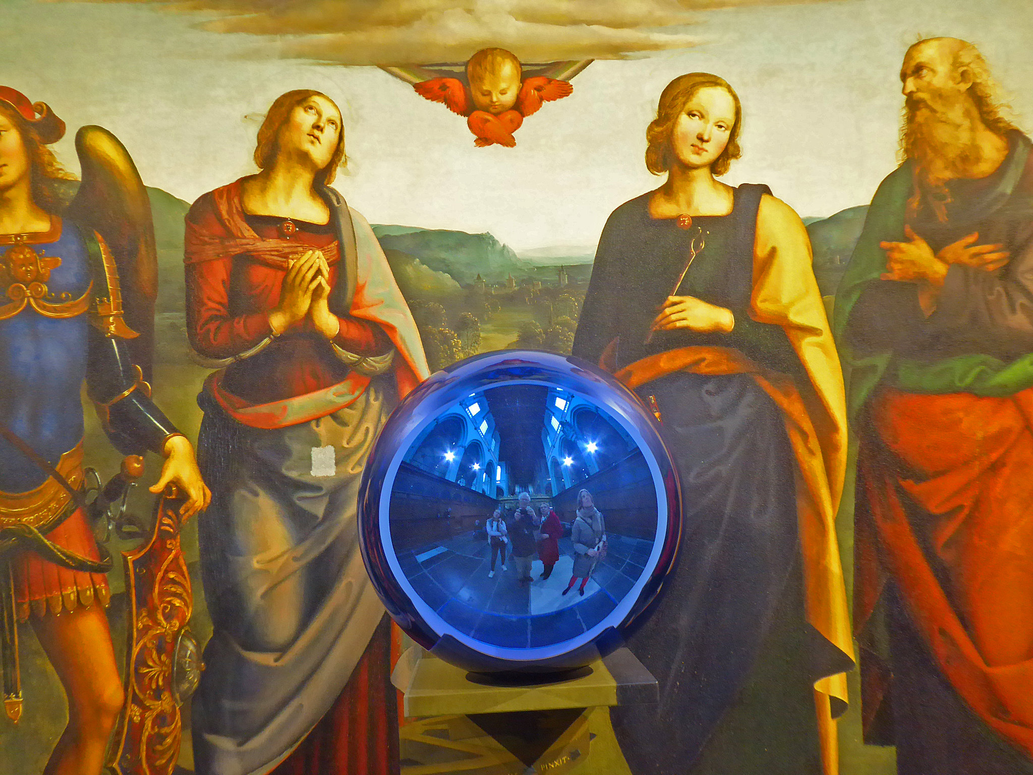 Detail of a Jeff Koons Gazing Ball painting. Photography by  Flickr user Ebe9 .
