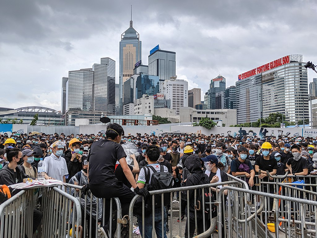 Protesters in Hong Kong demonstrating against the controversial bill that would allow criminal suspects to be extradited to mainland China. Photography by Studio Incendo. Courtesy of  Wikimedia Commons .