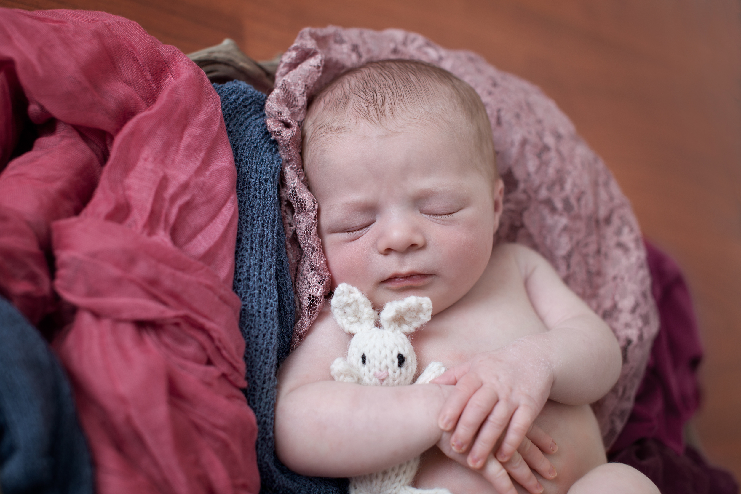 Columbus, Ohio photographer, Professional Portrait Studio, newborn photography. Infant in pink wraps with bunny.
