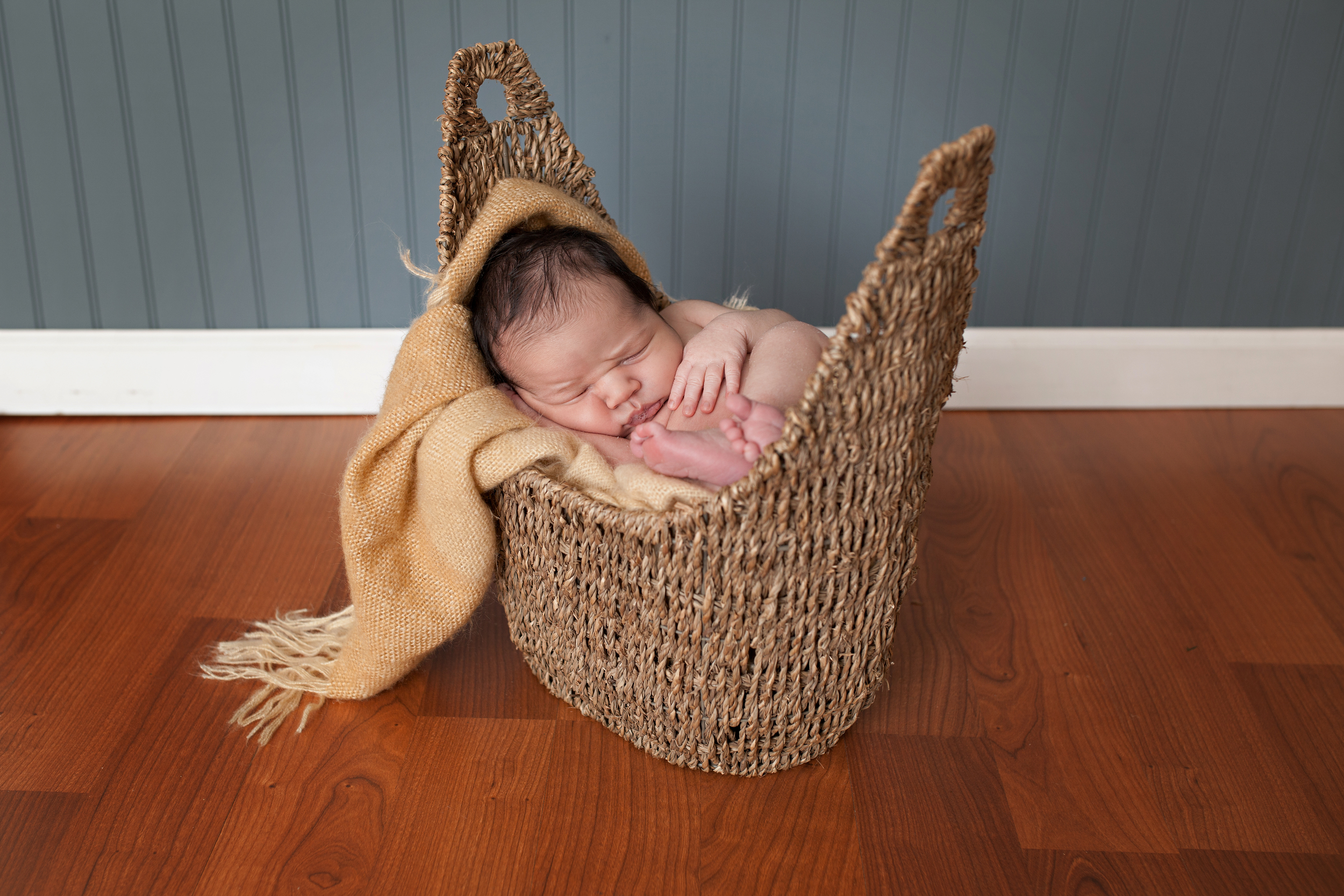Columbus Newborn photographer, specializing in baby photography. Baby boy posed in basket