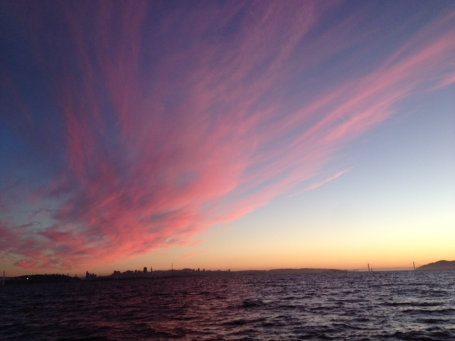 """Sunset over San Francisco Bay on Friday night, the evening before my departure to Munich, Germany. Spent the night anchored in a cove on """"Miss T,""""my favorite Beneteau 37."""