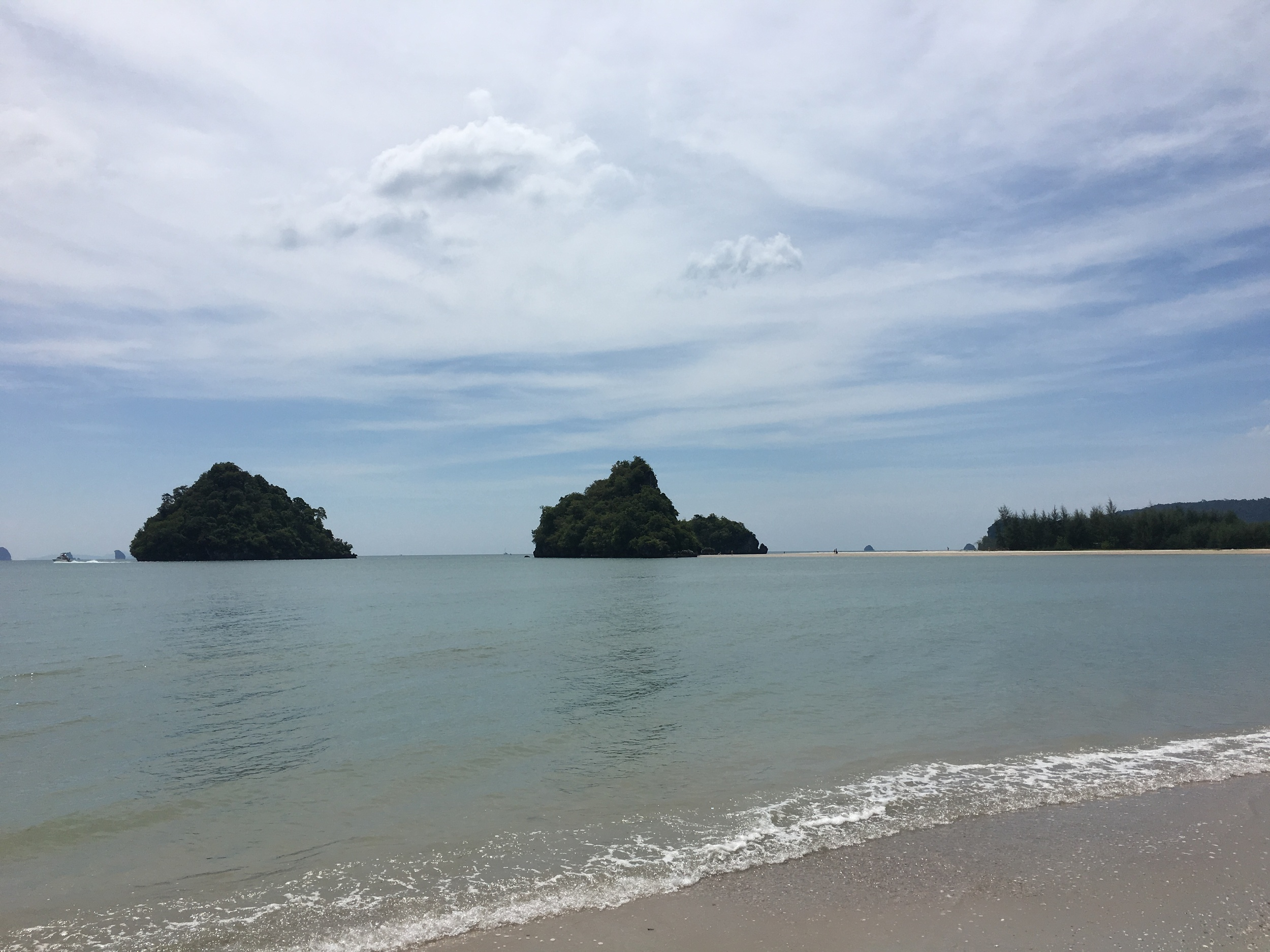 The beach at Ao Nang.  Nice, but I've seen nicer.  I took a swim out to those rocks.