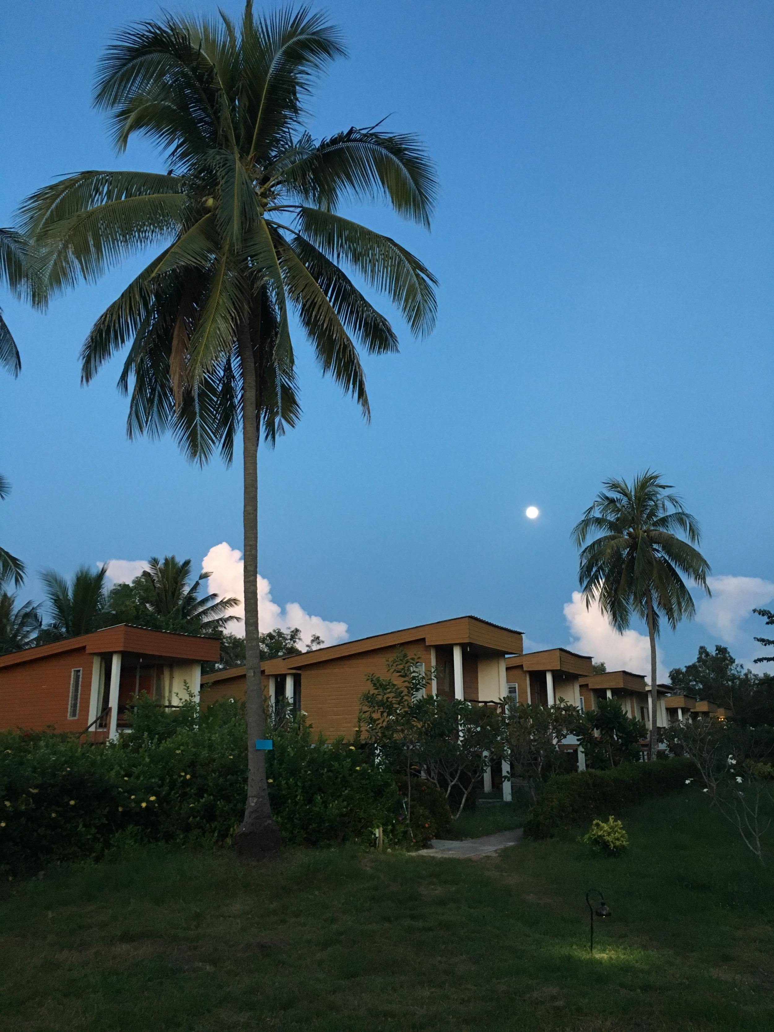 I moved into one of these bungalows.  Built on stilts, with wood plank flooring and no hot water, these bungalows provide a bit more rustic living. This picture was taking at dusk, with the moon rising in the east.