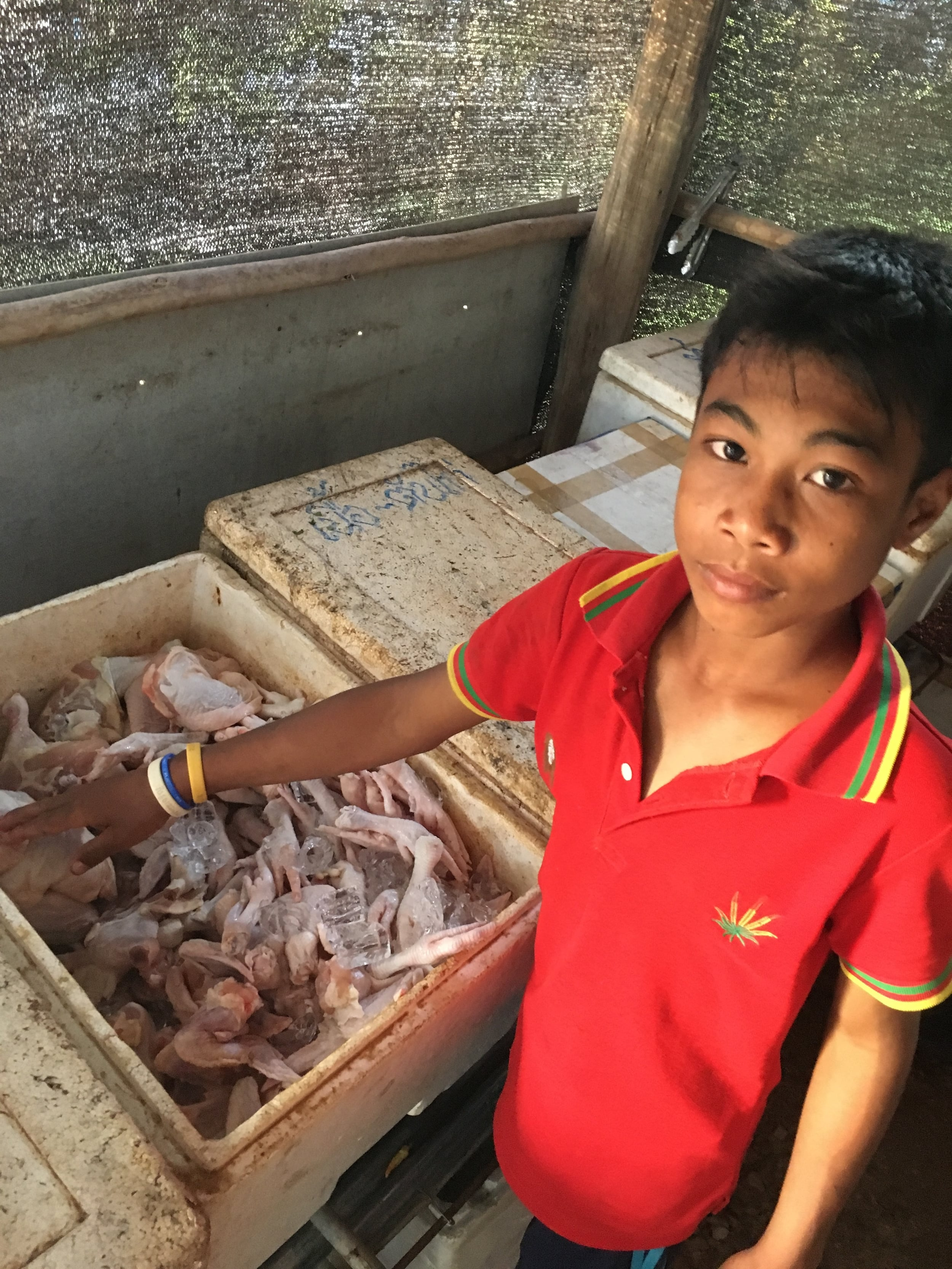 This young man helped us pick out our chicken for the New Year's Eve barbecue.