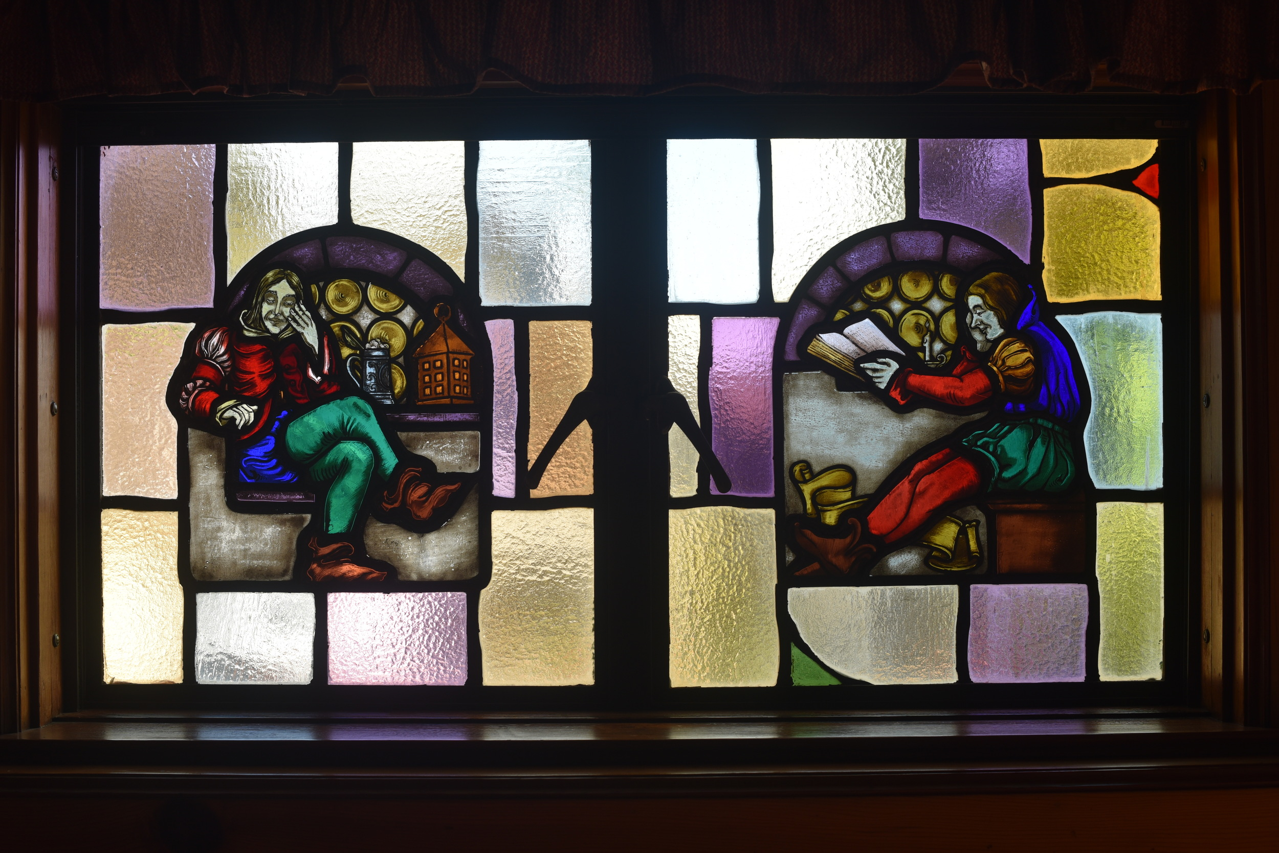 """This was the stained glass window in our wood-paneled den, or TV room. The room also had a red light in the left-hand corner and a green light in the right-hand corner. I never really made sense of this until now -- after 4 years of sailing -- these are nautical """"running lights."""" Red is left, port side. Green is right, starboard side. All these years later, I see these hints about sailing that were right in front of me for 18 years living in this house!"""