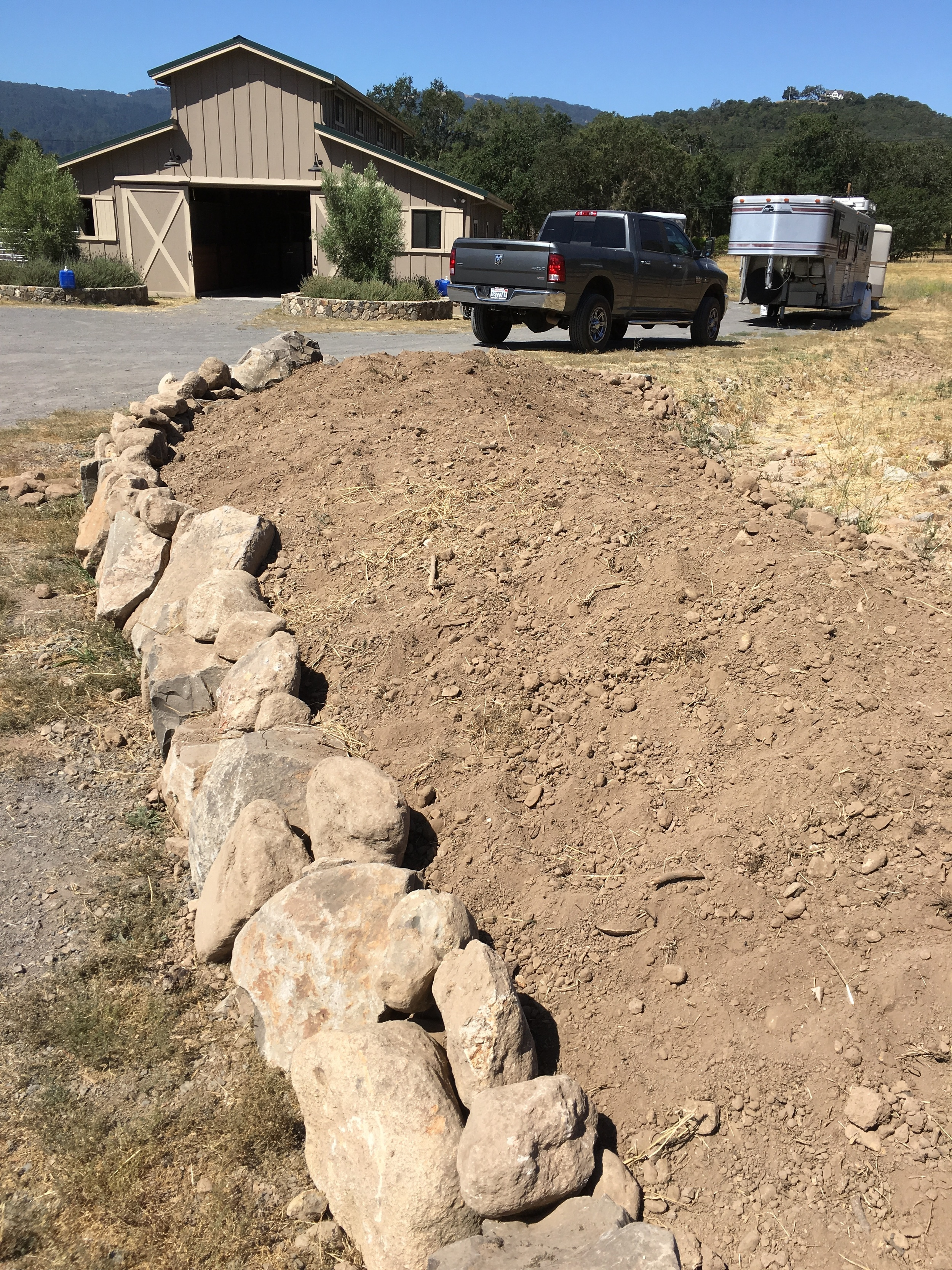 One of the berms, with rock retaining wall.