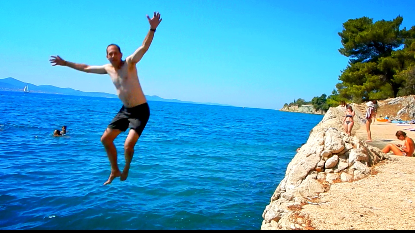 Jumping off a small cliff into the Adriatic Sea for the first time.  Warning:  Don't zoom in - beware the farmer's tan and executive's body.