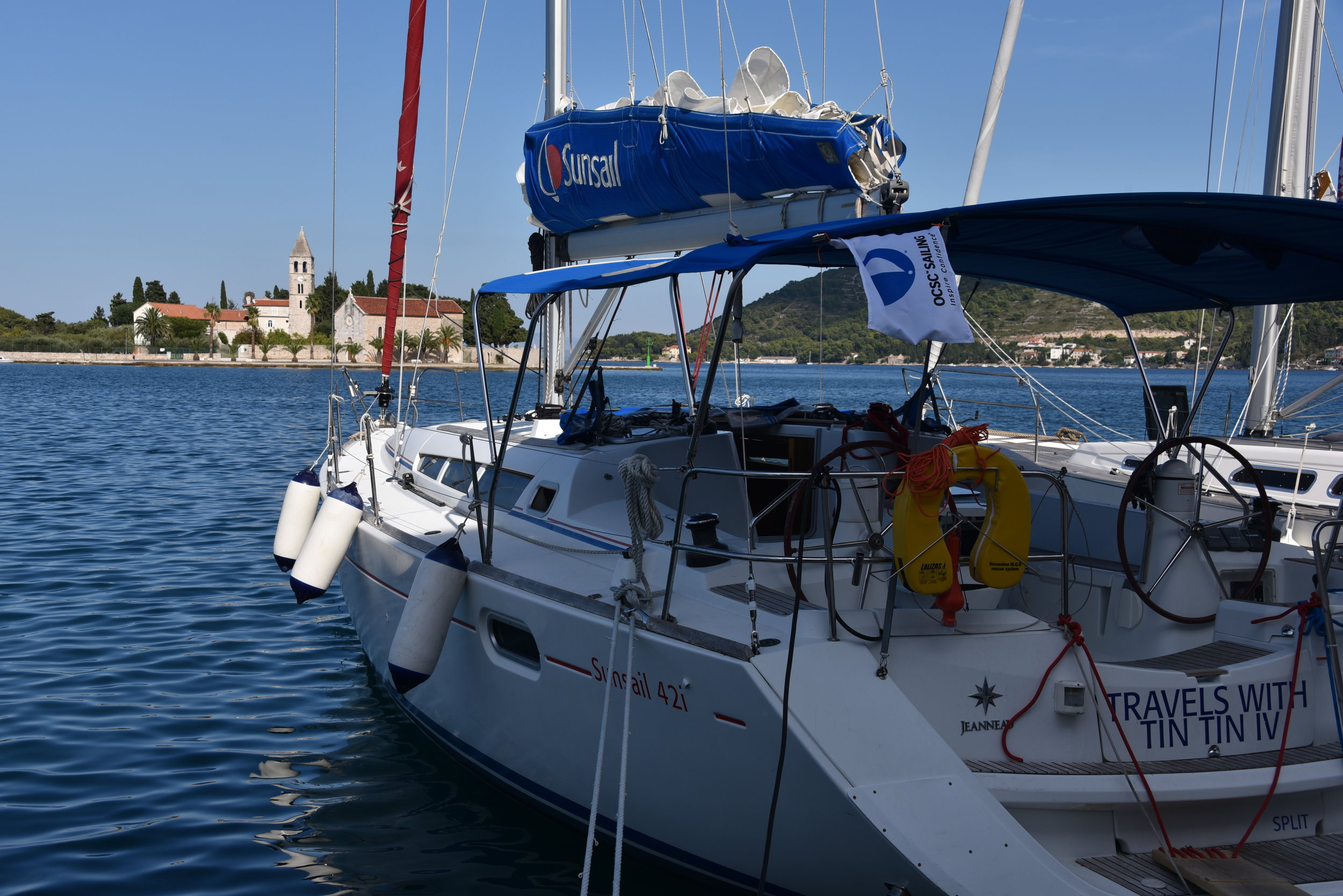 Moored in Vis Town, along the promenade and facing the church and harbor entrance.