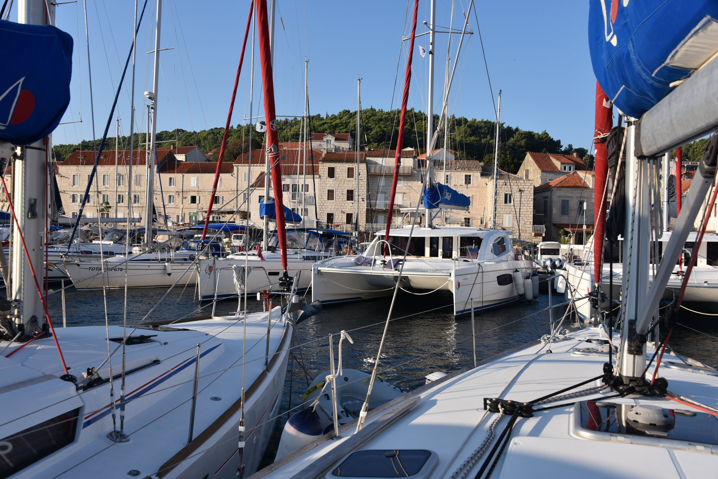 Very close quarters in the marina at Korcula! We used a spring line in our departure with wind blowing 10 knots. The spring line enabled us to make a very sharp turn to the left, before we hit those big catamarans staring us down. :-)