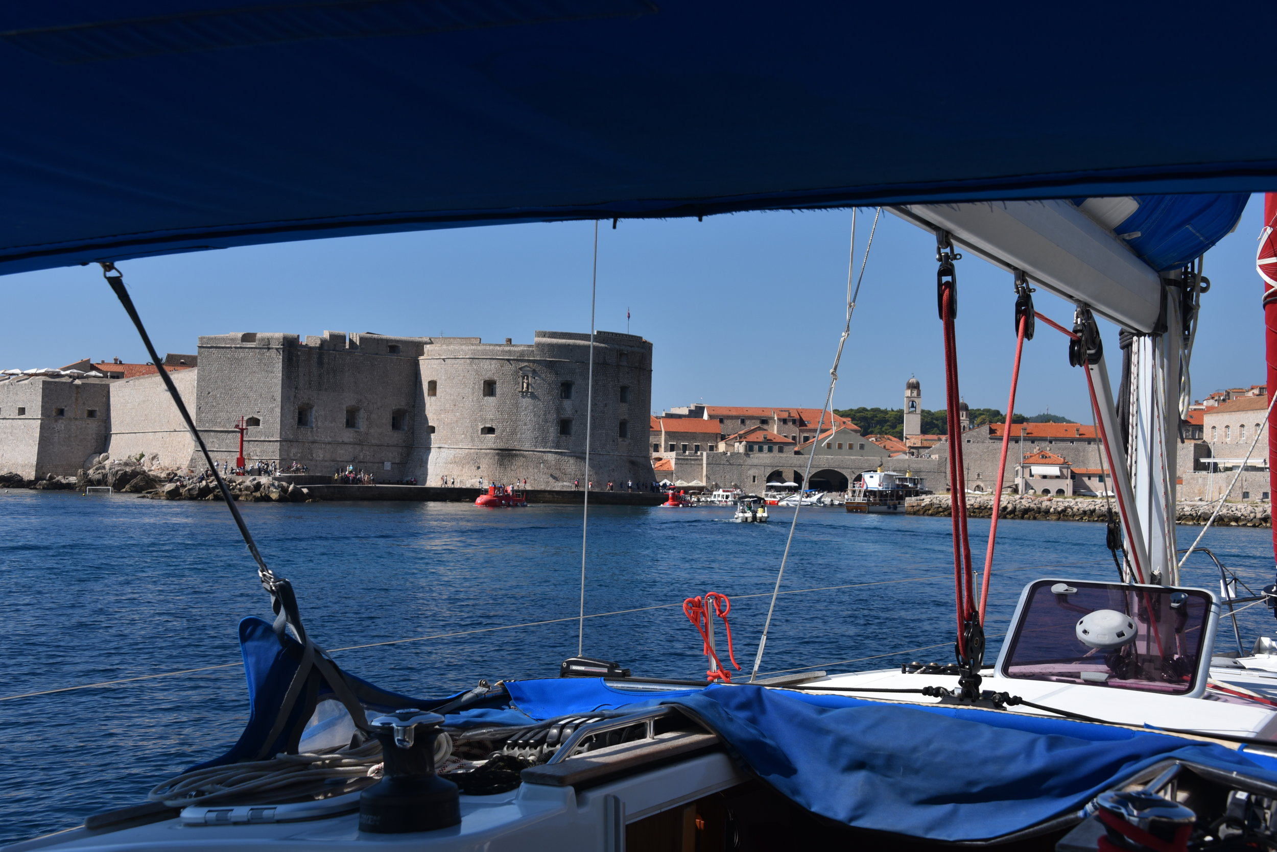Peeking into the small but very busy harbor inside the walls.