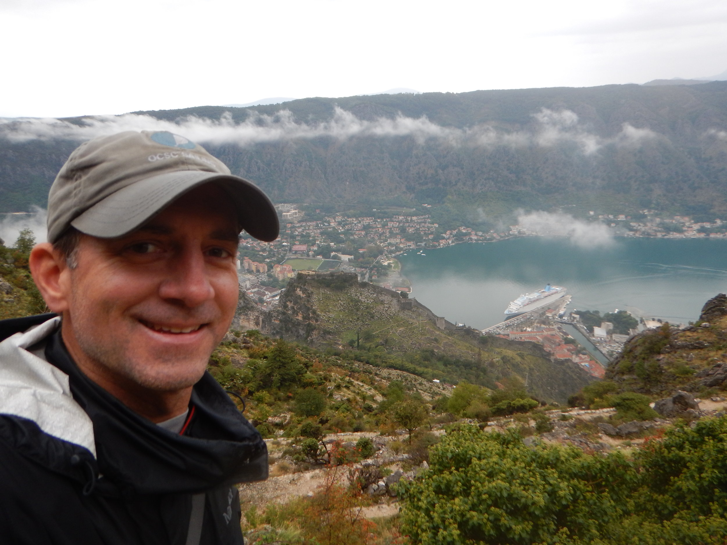 Hiking up the Ladder of Cattaro (Kotor), looking back down on St. John's Castle and the famous wall along the hills.
