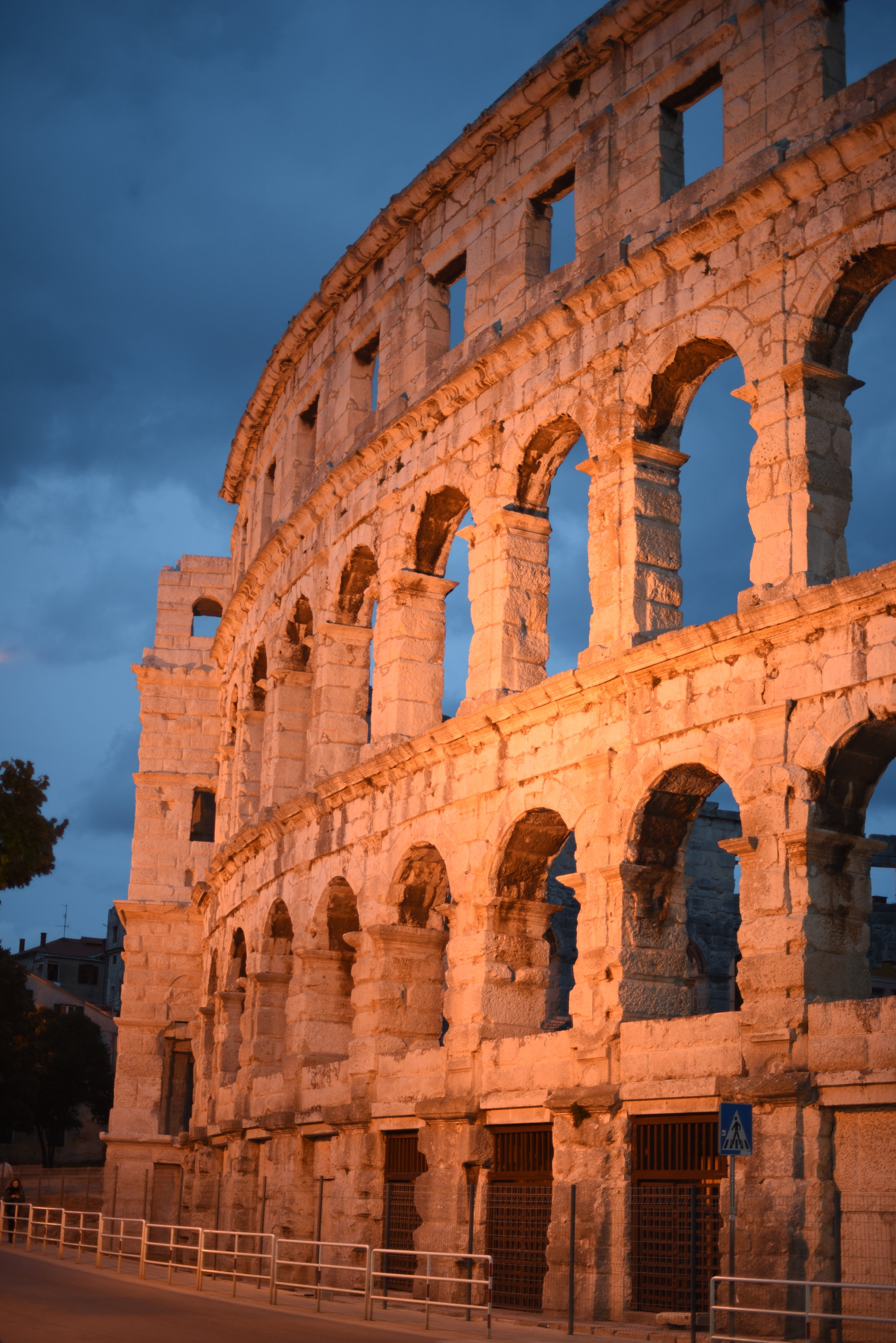 The Pula Arena illuminated in the evening.