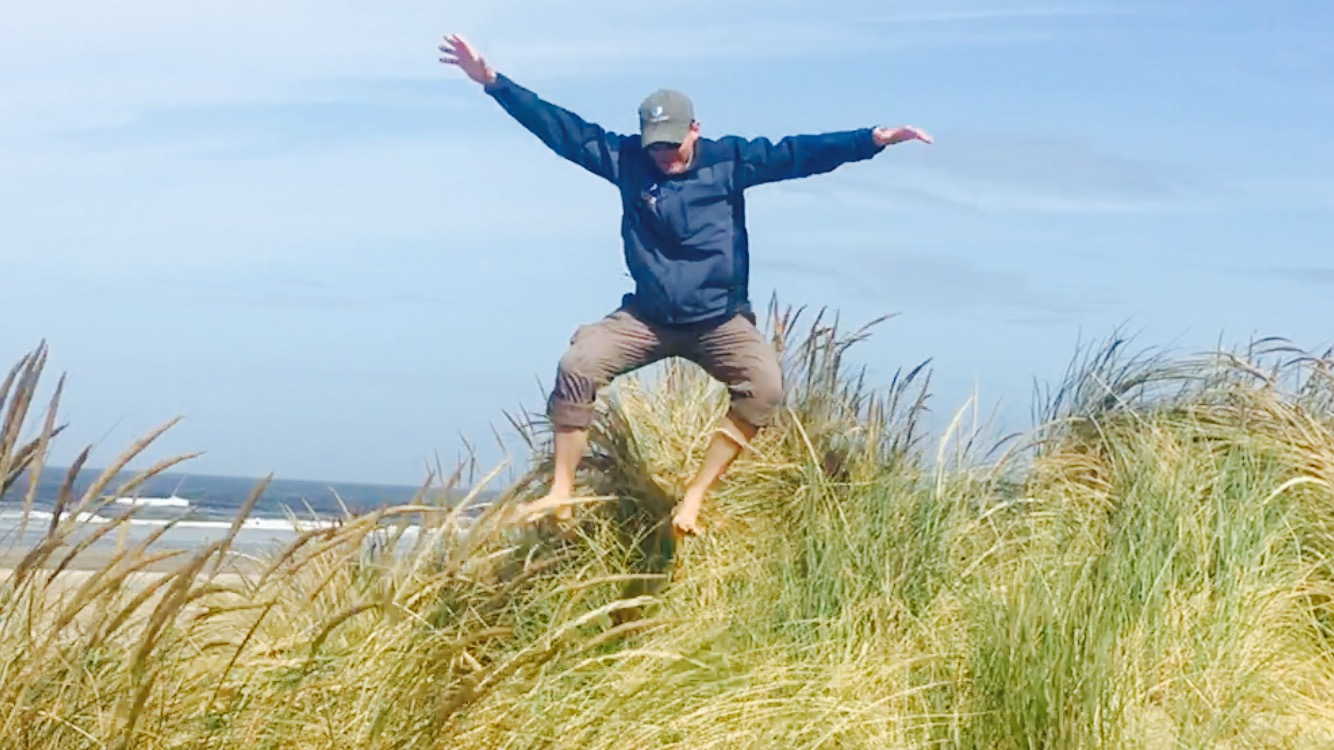Playing in the sand dunes on the Oregon Coast.