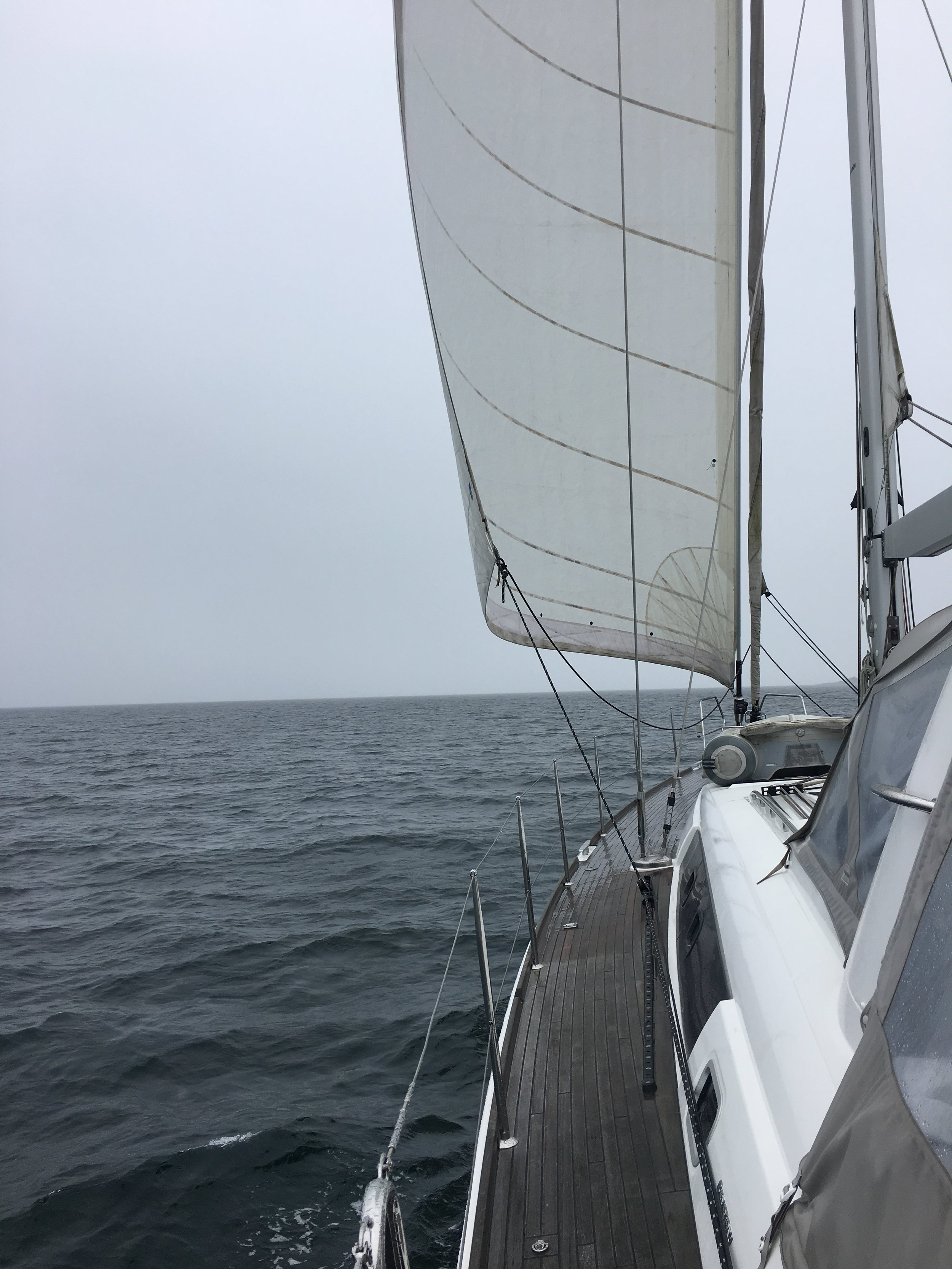 First day sailing in 20 knots of wind from behind us, so we unfurled the genoa.