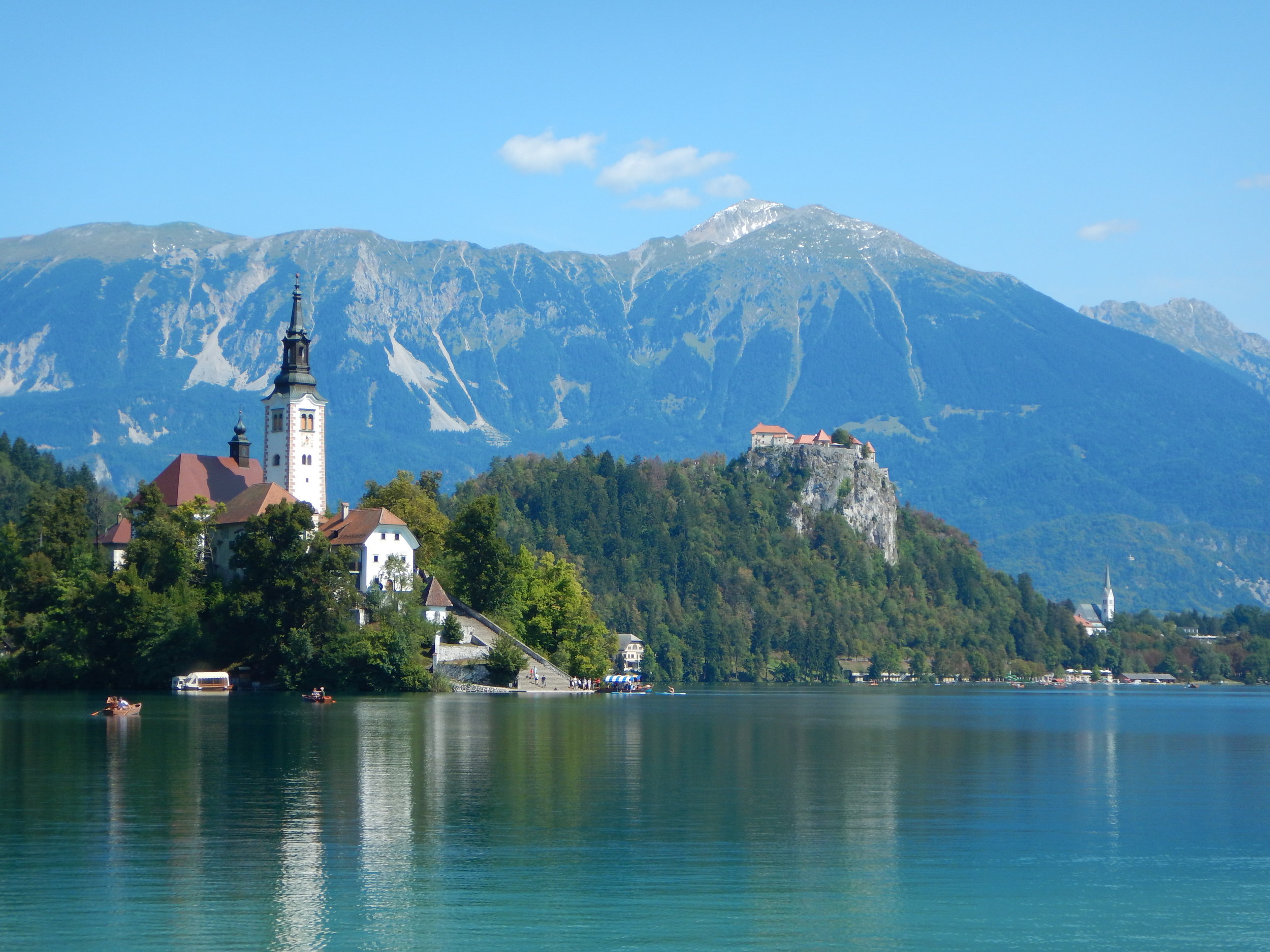The view of the castle and church, from the south side of Lake Bled.