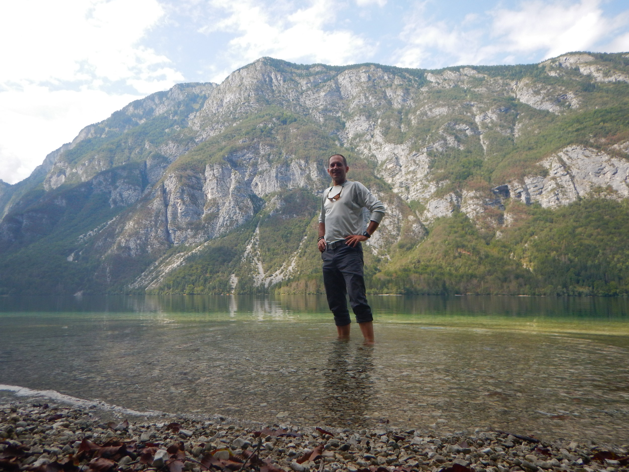 Wading in the refreshingly cool water of Lake Bohinj after a long day of hiking.