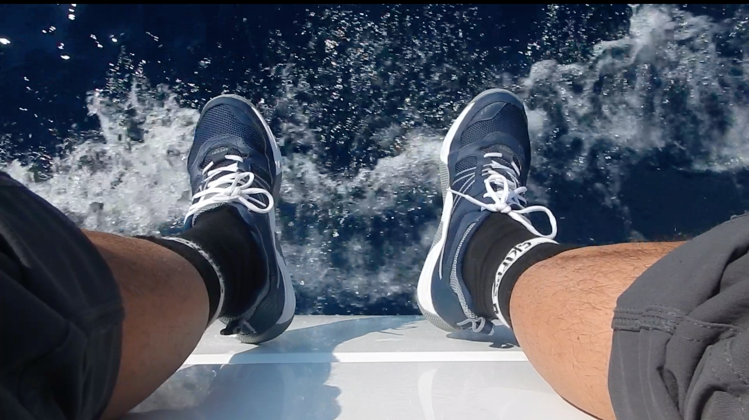 "Showing off my ""skipper socks"" as we make way to Slano."