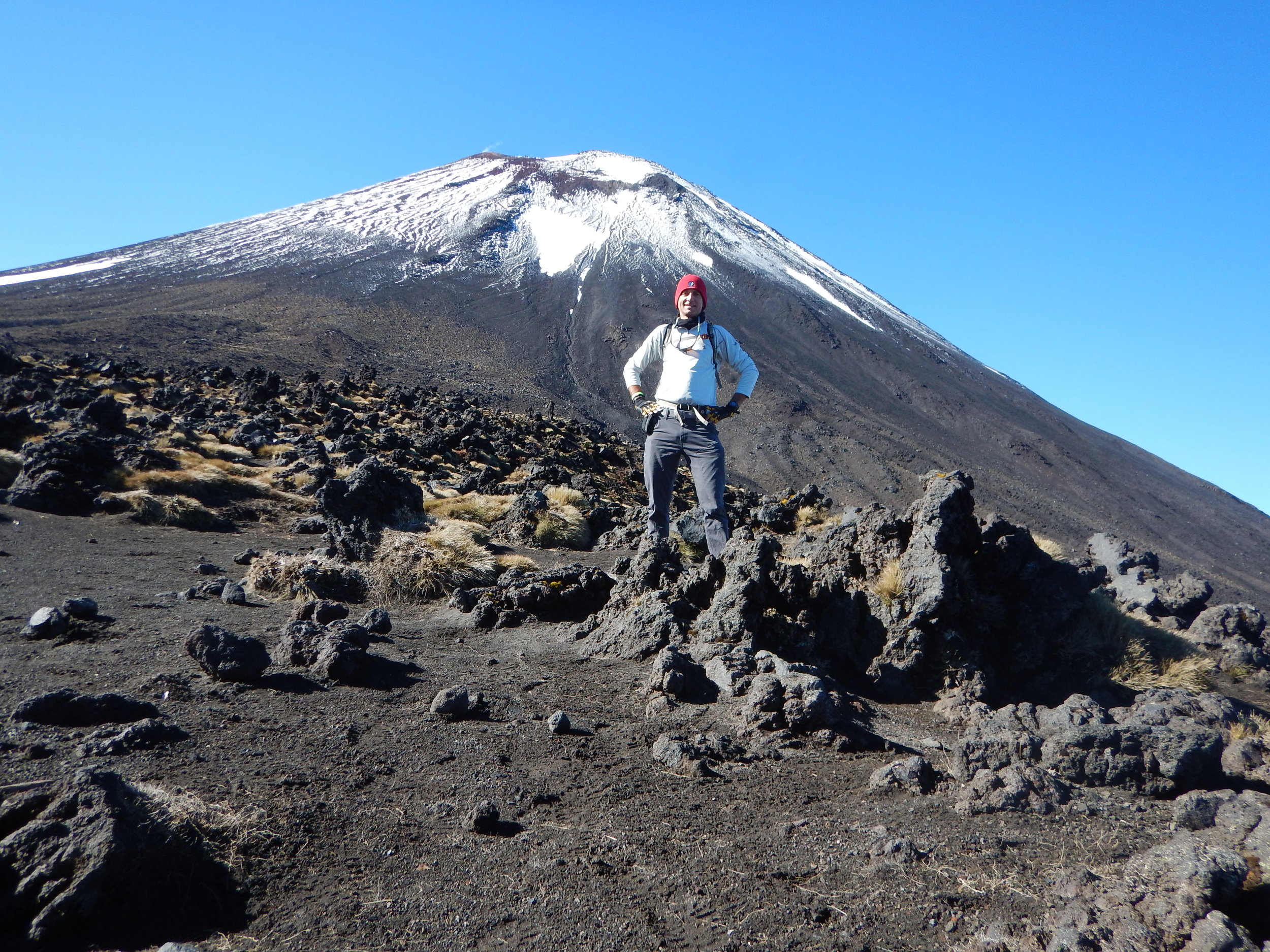 In front of Mt. Ngauruhoe (Mt. Doom). Wish I had planned for the extra two-hours to make the ascent! (An optional portion of the Tongariro Alpine Crossing.)