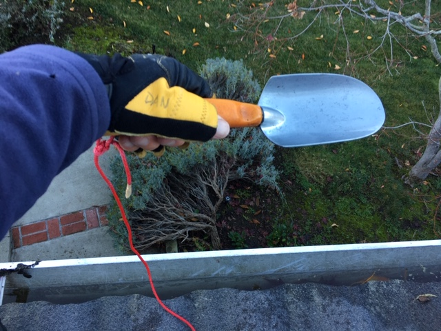 Sailing gear came in handy while cleaning gutters. Gloves to protect my hands from sharp metal edges. Safety line to prevent the trowel from falling off the roof. Unfortunately, no safety line for me…