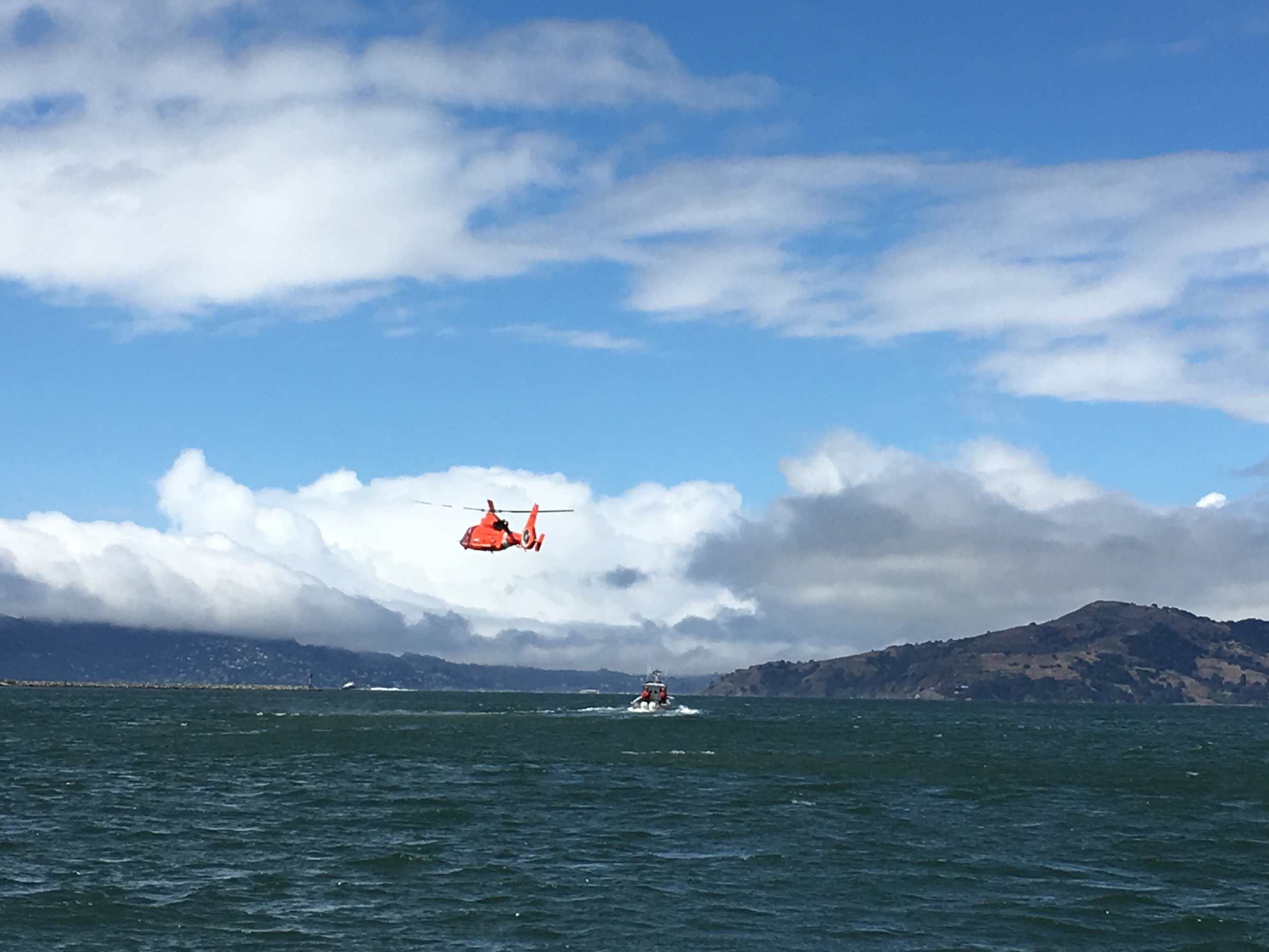 Occasionally we see the U.S. Coast Guard practicing maneuvers in the Bay. Here, the helicopter was hovering over and following the RIB vessel.