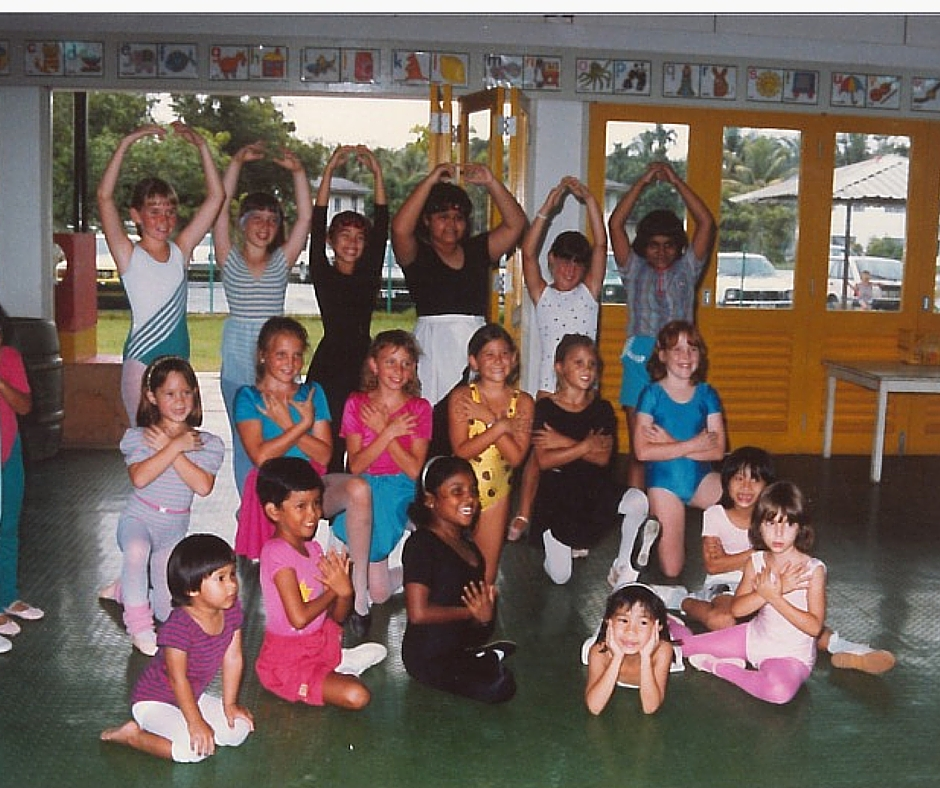 "Jodie is the front row with her head in hands.  She says ""I look at this photo and it makes me smile, makes me realize that maybe I was born to always stand out.  This was taken in my dance class in Brunei."""