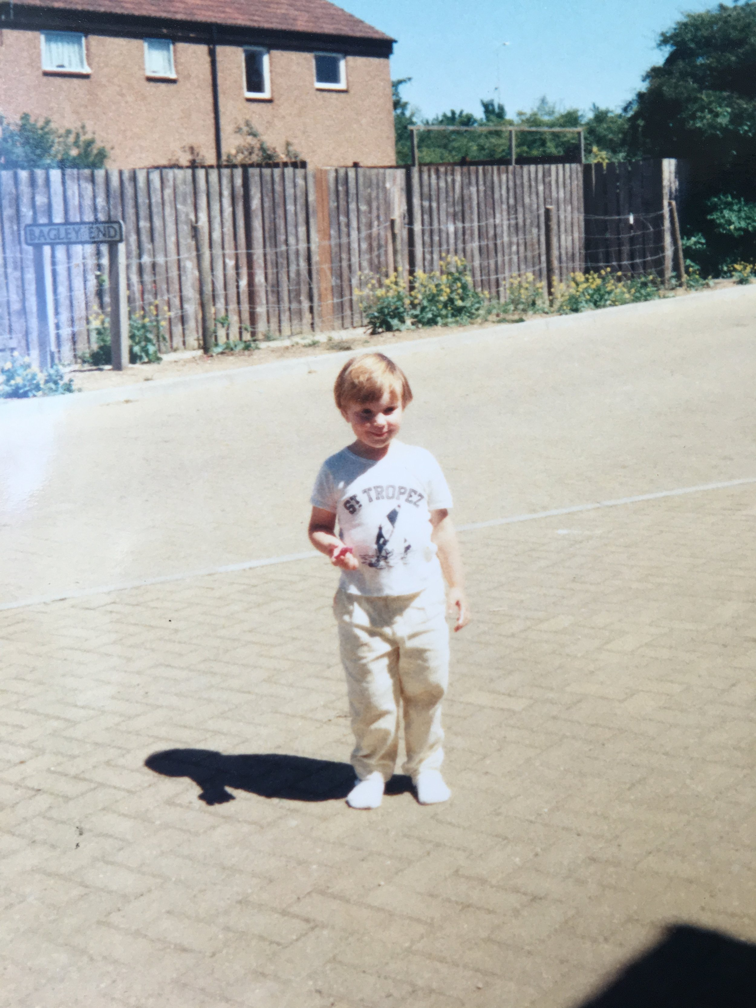 Me in front of the house I grew up in a few years before I met the local paedophile.
