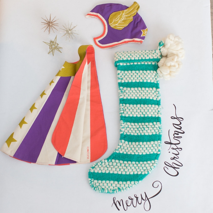 Styling by Mari Spiker,Cape and Helmet by Love Lane Designs, stocking by Anthropologie, calligraphy by Octavia Spiker