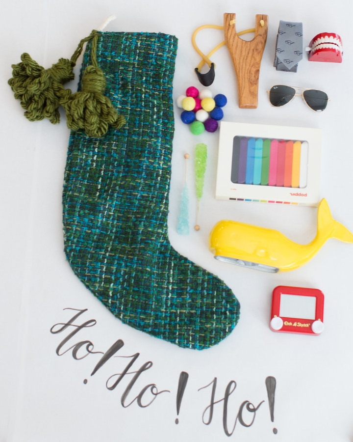 Styling by Mari Spiker, stocking by Tinsel, calligraphy by Octavia Spiker, sling shot set/ray-ban sunglasses/crayon set at Peek Kids, mini etchasketch/whale bank/chattering teeth by The Land of Nod, and tie by CrewCuts.
