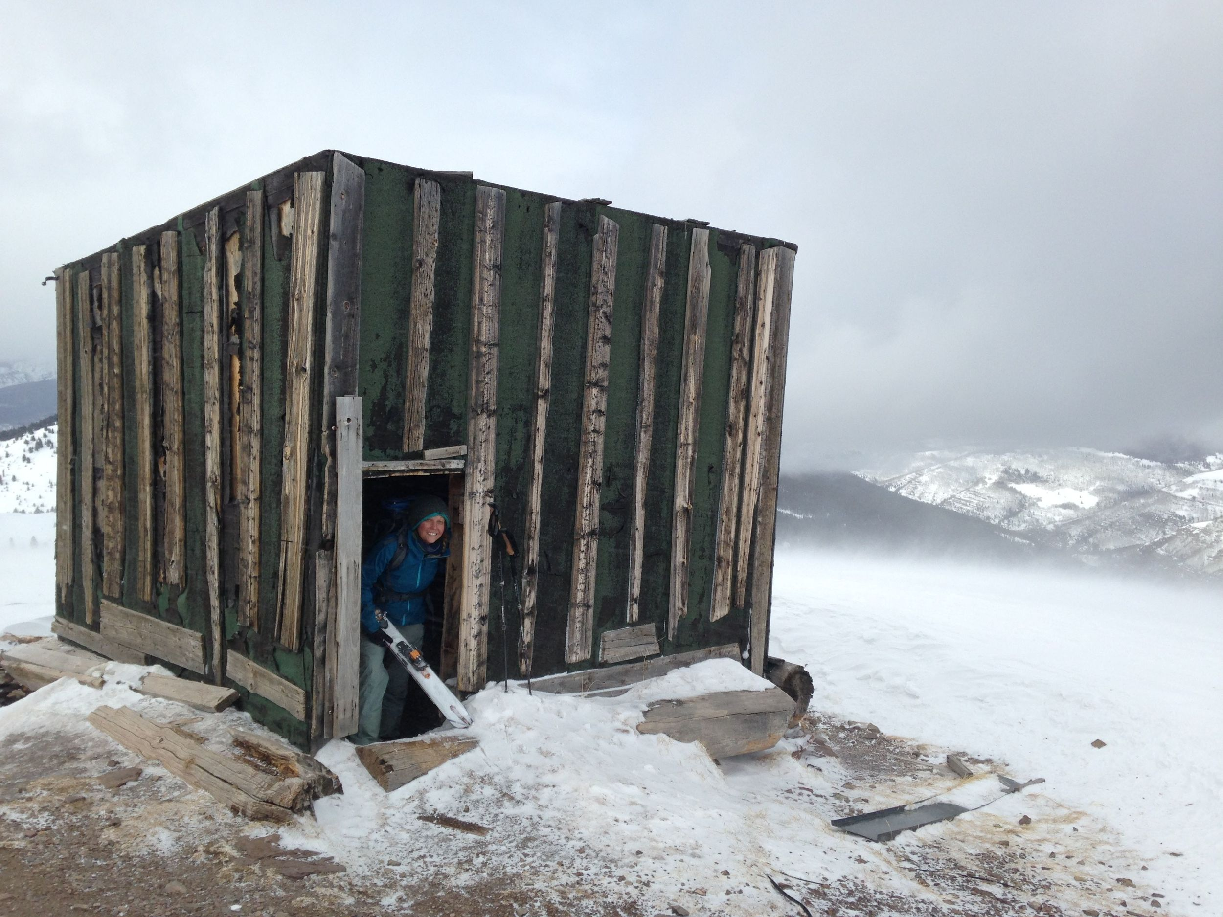 seeking shelter from the wind on ptarmigan hill