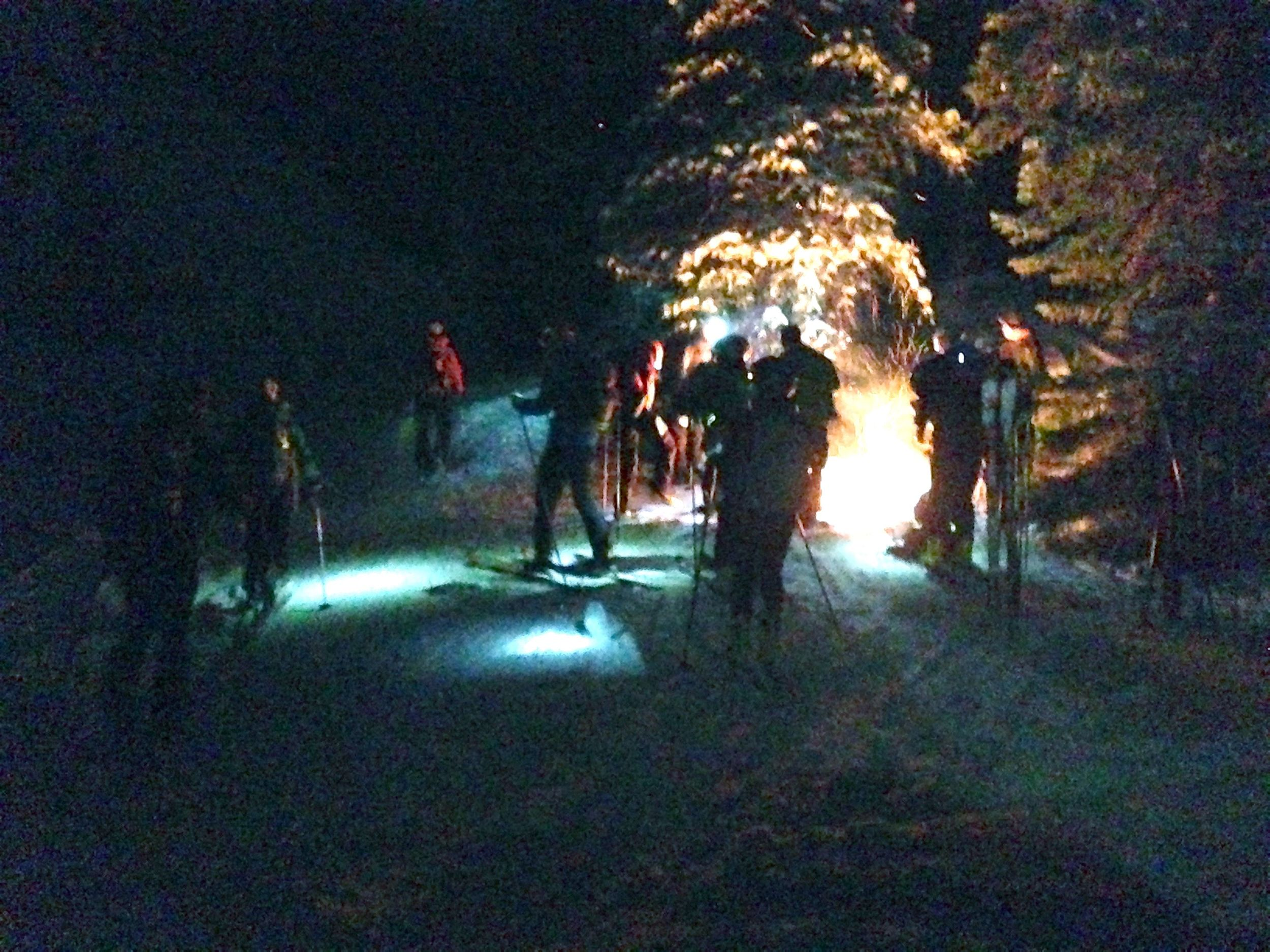 racers regrouping at a bonfire checkpoint.