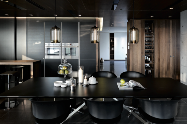 A dramatic black kitchen gets a touch of warmth from natural—but also dark—wood - LEICHT Küchen AG