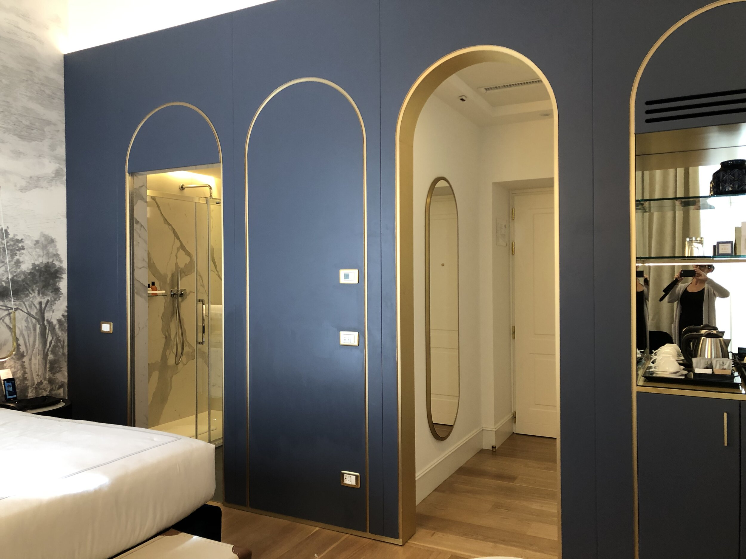 Probably the best color of blue we have ever seen was introduced on the wall separating the sleeping area from the utilities. You can see the gold accents better here.