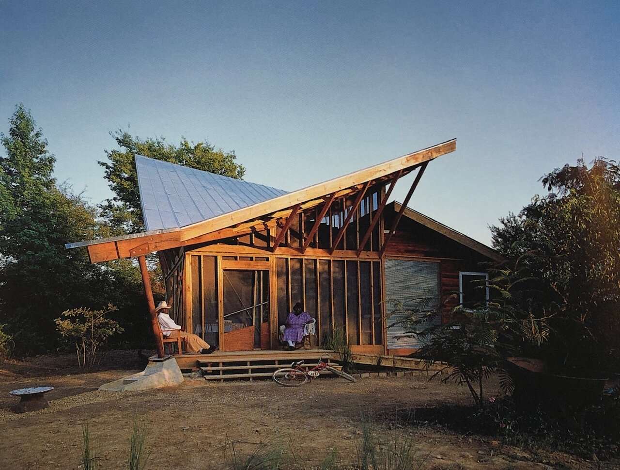 "[The Harris ""Butterfly"" House, Mason's Bend, 1997, Photo by Timothy Hursley] ""No I don't think I'll take one of those today,"" Anderson Harris, who at first was not interested in what the Rural Studio was offering. Relationships were cultivated with Harris ultimately working alongside the students. The resulting structure, with a construction cost of $25,000, amplifies the importance of the family's porch and low cost sustainable strategies."