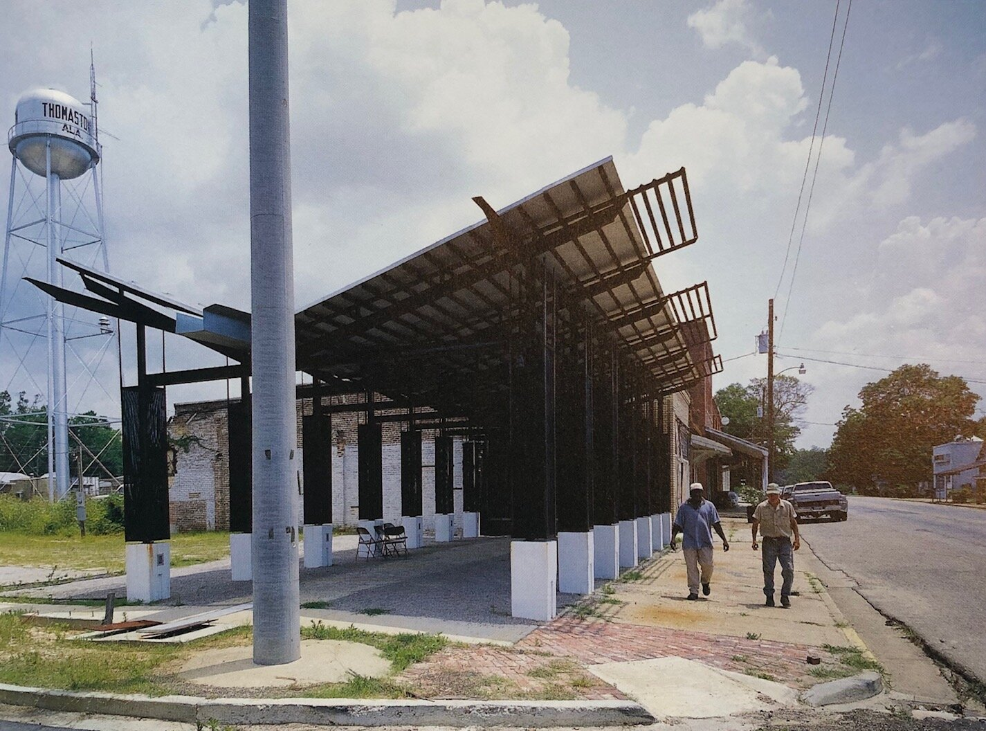 "[Thomaston Farmers Market, 2000, we're looking at you Jeff Johnston @SMHa, Photo by Timothy Hursley] This structure is the first foray into economic / town development with the initial goal of ""creating a dialogue between the Farmer's Market, the coop grocery and a local canning kitchen business."" The power is in the simplicity of the steel column grid, correctly sized stalls and lofty roof covering."